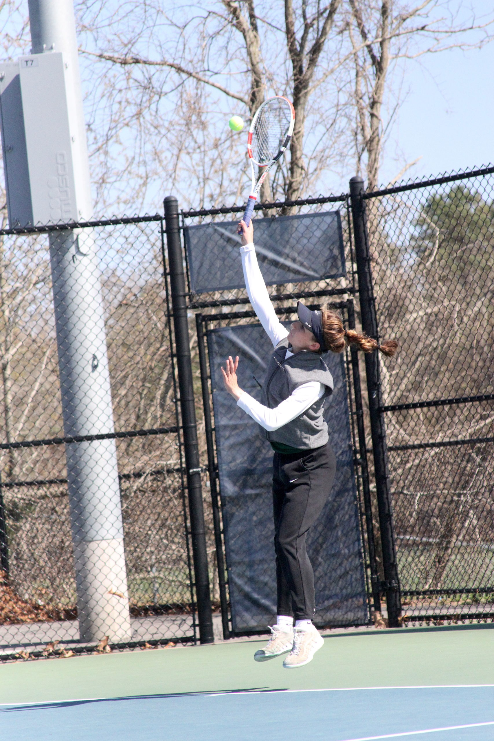 Westhampton Beach junior Rose Hayes serves the ball during her Suffolk County singles quarterfinal match.