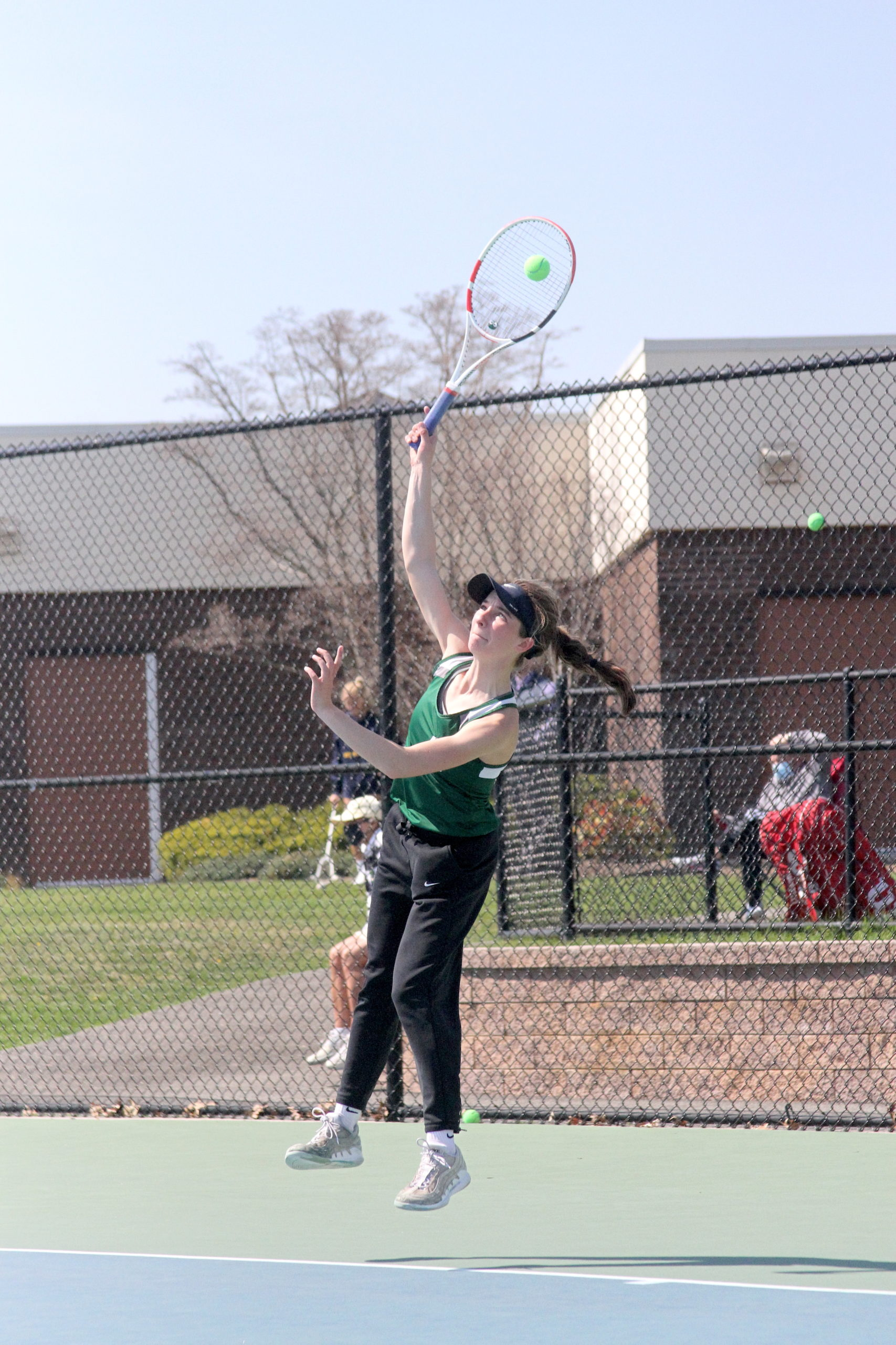 Westhampton Beach junior Rose Hayes serves the ball in the Division IV singles finals.