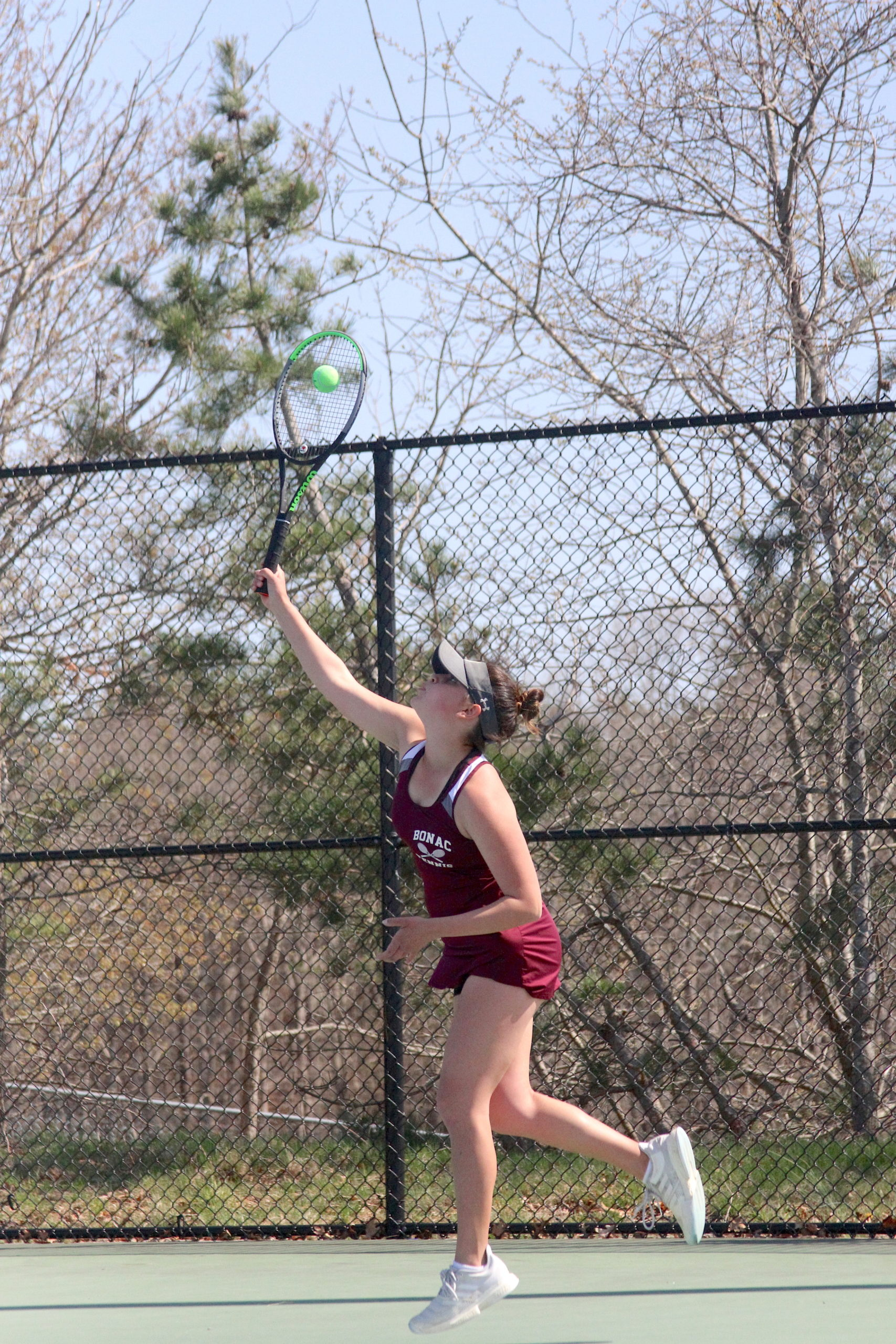 Pierson junior Sandrine Becht serves the ball for East Hampton in the Division IV doubles finals on Tuesday.