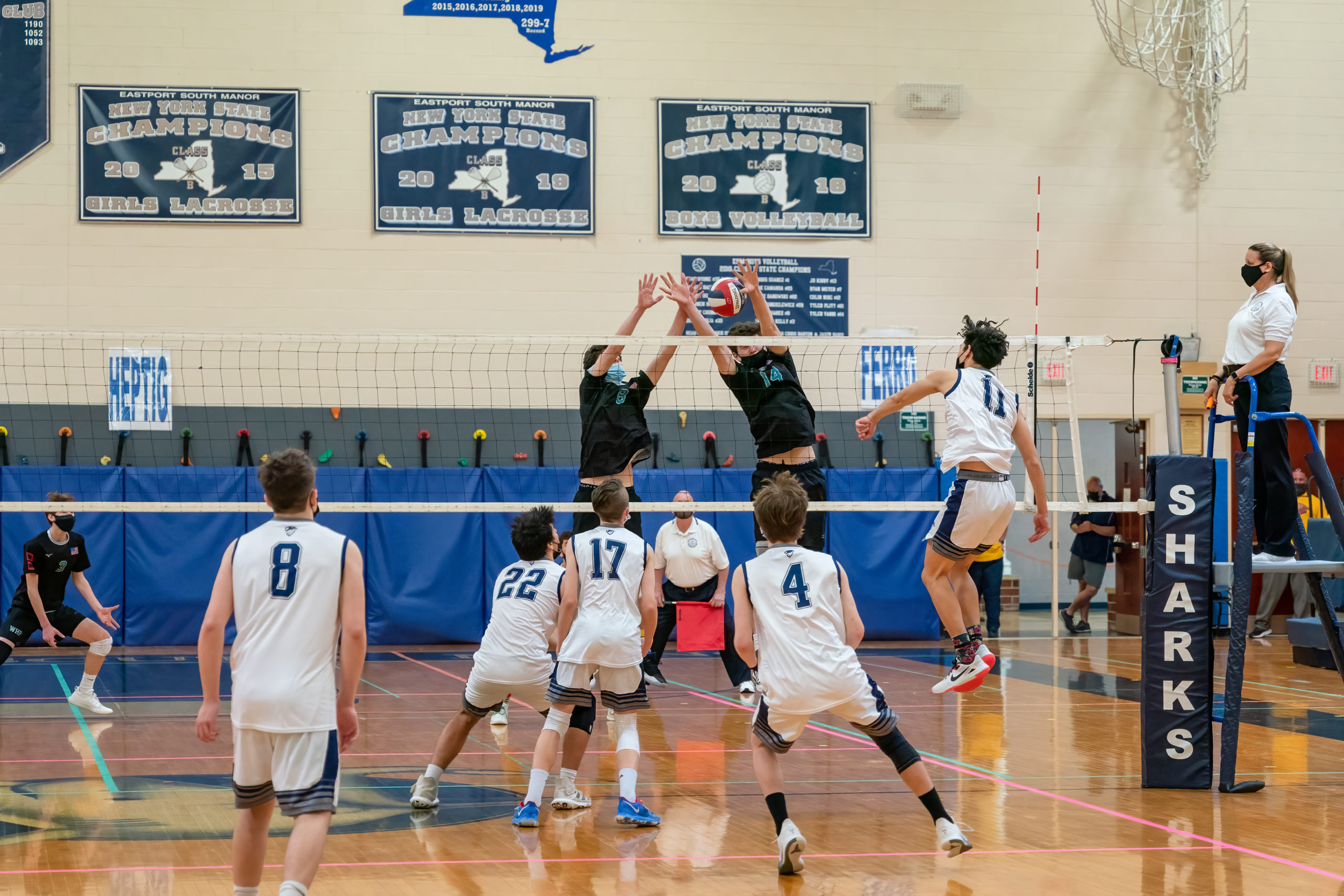 Hurricanes Colbie Mason, left, and Daniel Haber set up a block at the net.