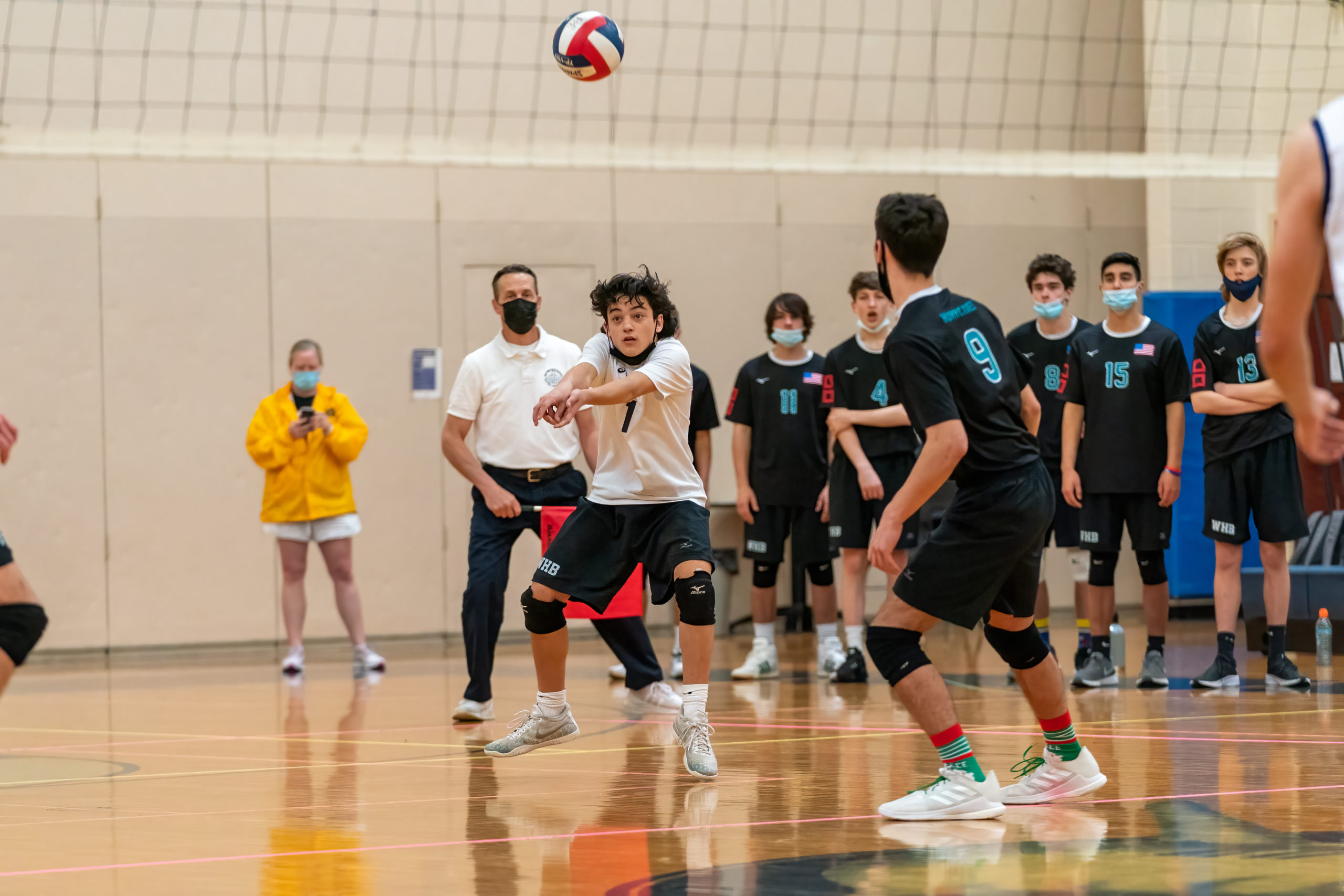 Westhampton Beach senior Carter Papagni records one of his 14 digs.