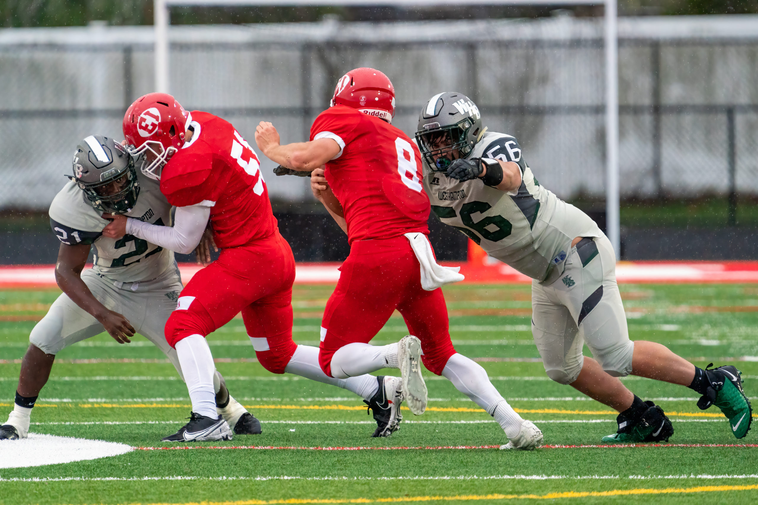 James Foster of Westhampton Beach goes to wrap up East Islip quarterback Steven Stassi.