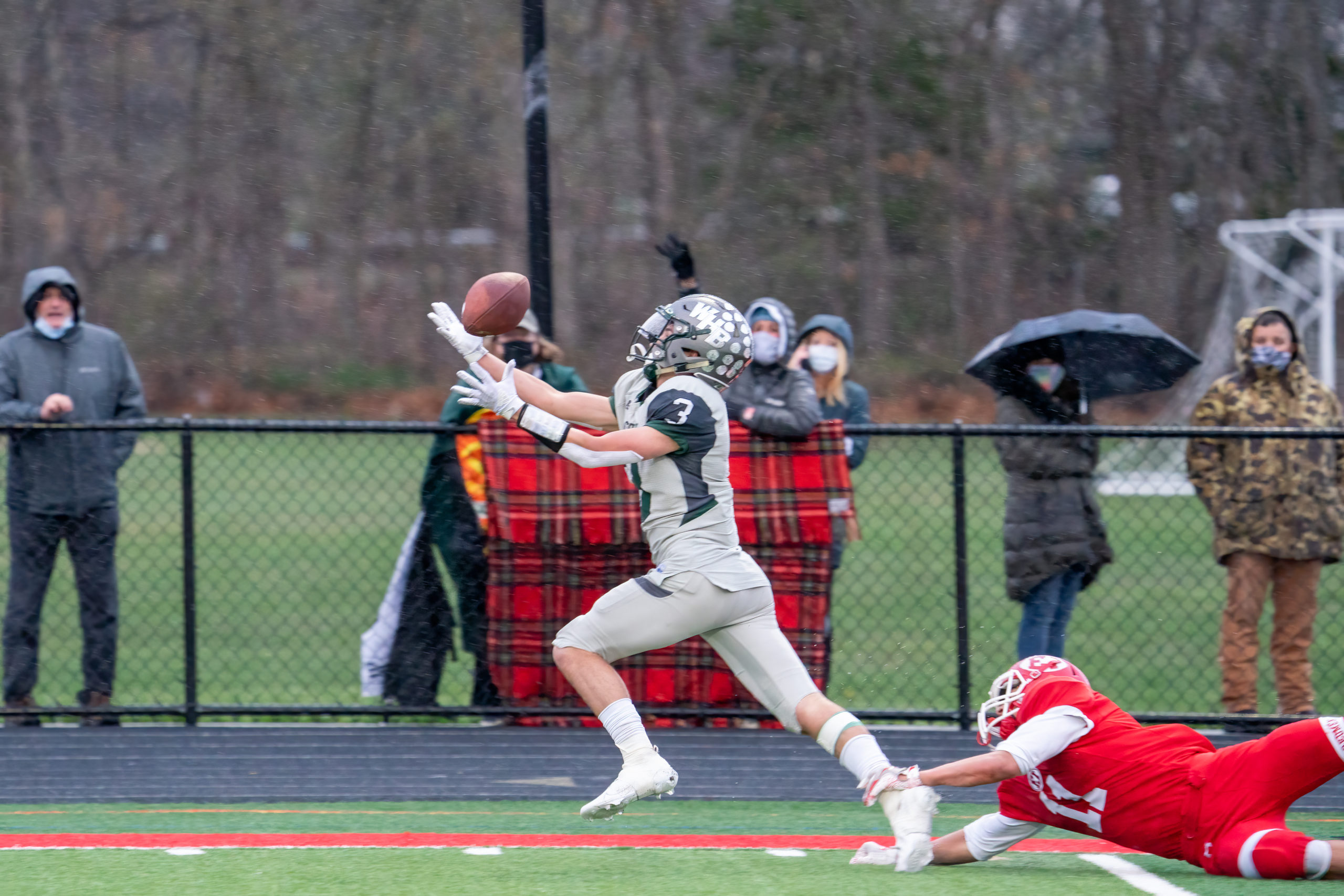 Owen Spizuoco catches a deep pass from quarterback Christian Capuano down the sideline, eludes an East Islip defender, and scurries into the end zone to pull Westhampton Beach closer to East Islip's lead with just under a minute left in the first half.