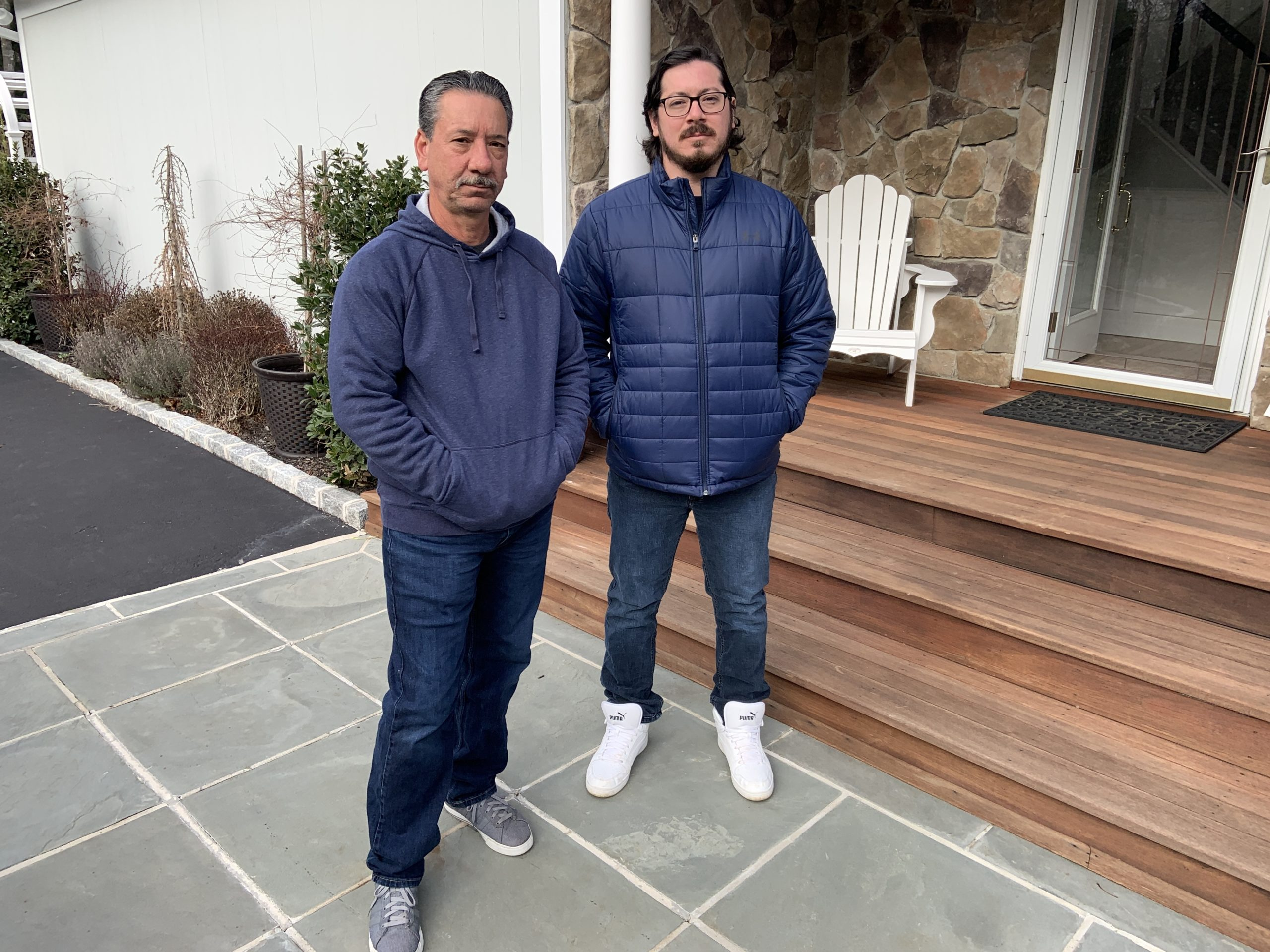 Louis DiPasquale, left,  with his son, Louis DiPasquale III, who has been living with his parents in Quiogue after returning from military service in Cuba because a tenant refuses to leave a Sound Beach house that was intended for him.