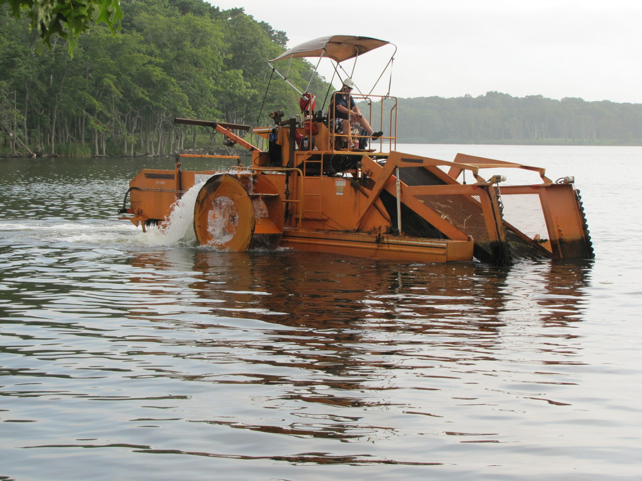 The floating tractor known as an aquatic weed harvester has been an important cog in the Friends of Georgica Pond's fight to control algae blooms in the pond.