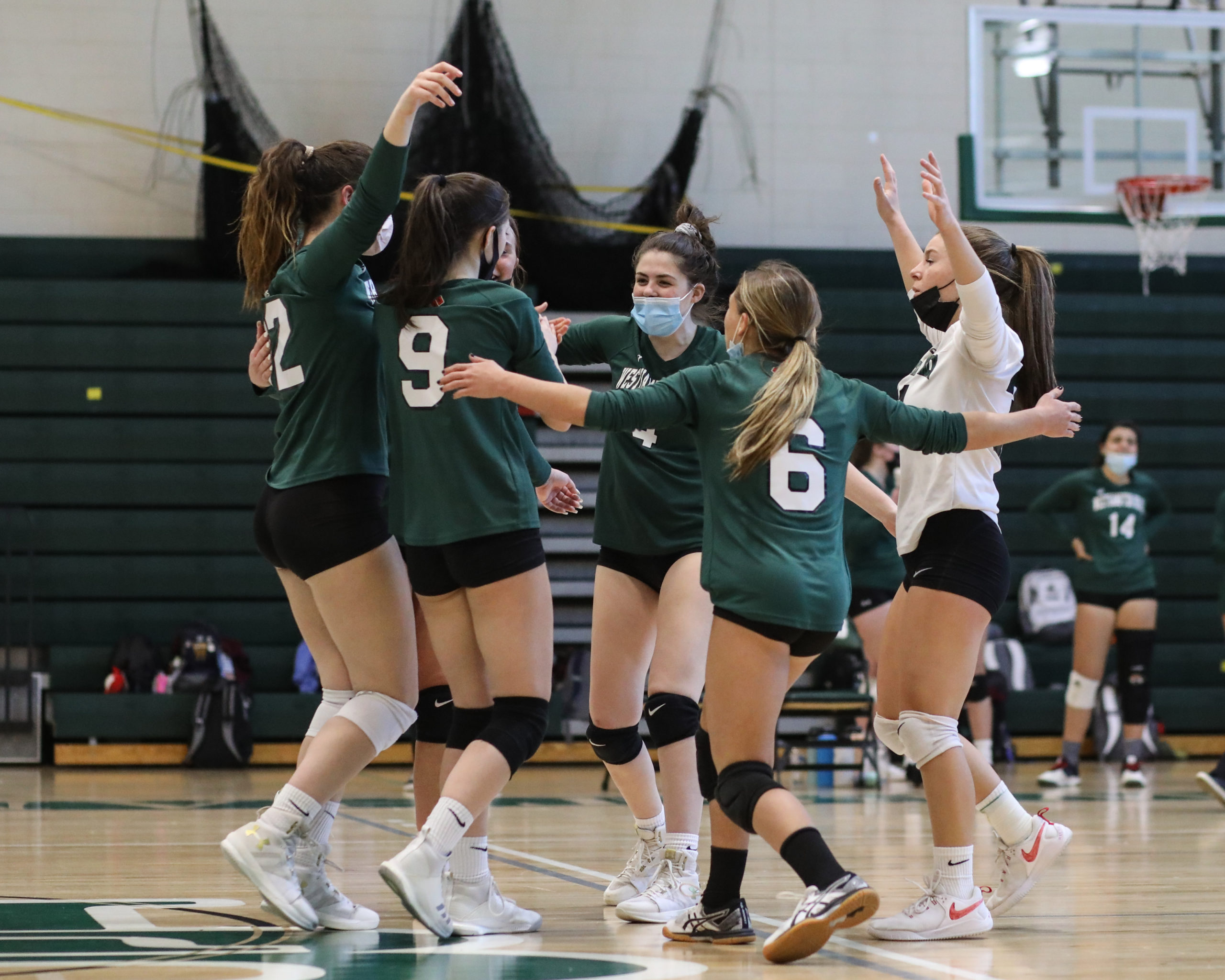 Westhampton Beach's girls volleyball team celebrates its first-set win over Kings Park.