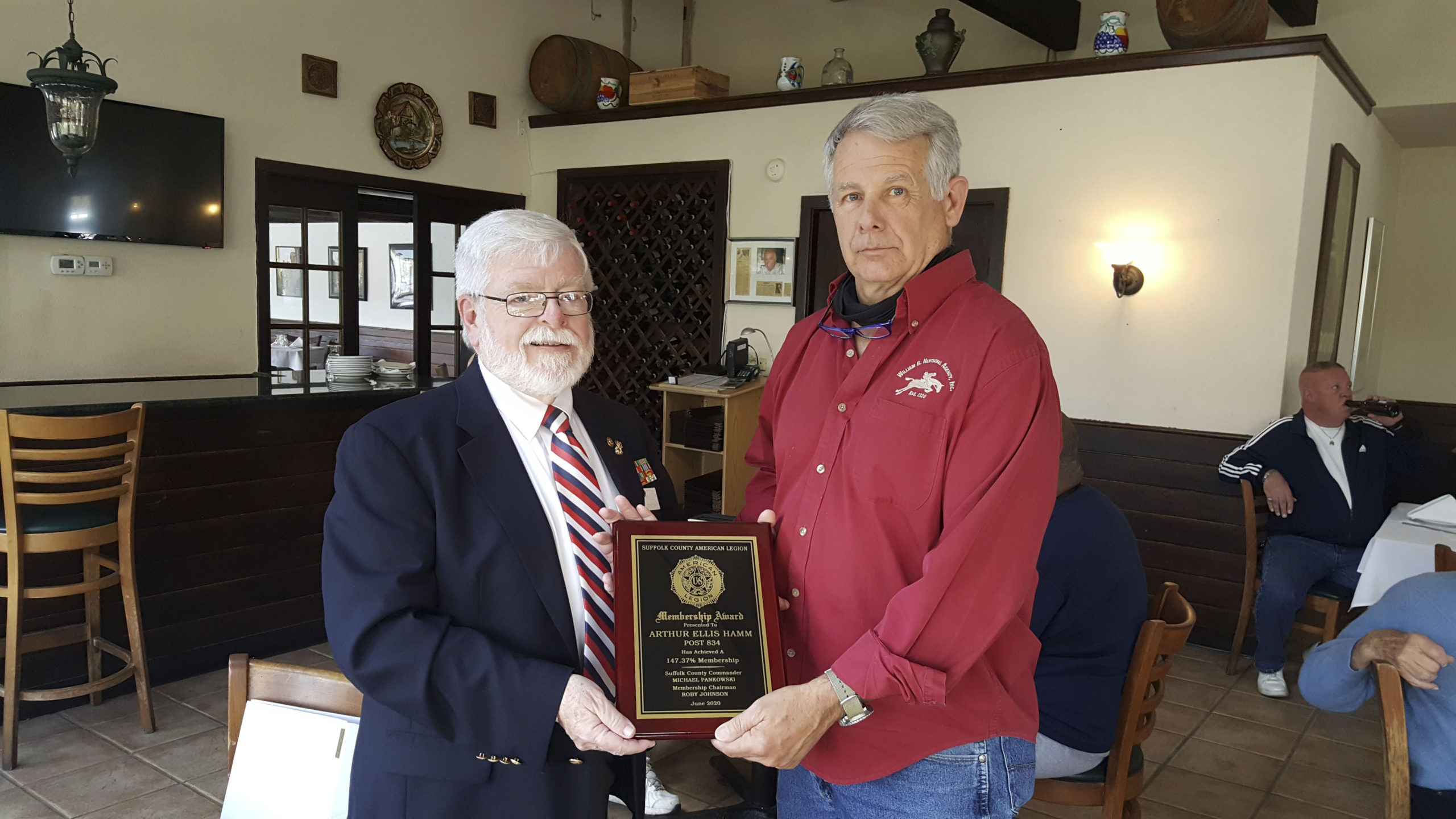 Membership Chair Fred Bauer of the American Legion Arthur Ellis Hamm Post 834 in Westhampton recently accepted a plaque of acknowledgement of a 20% increase in membership  from Rob Robesch, current judge advocate for the 10th district and past Nassau County Commander.