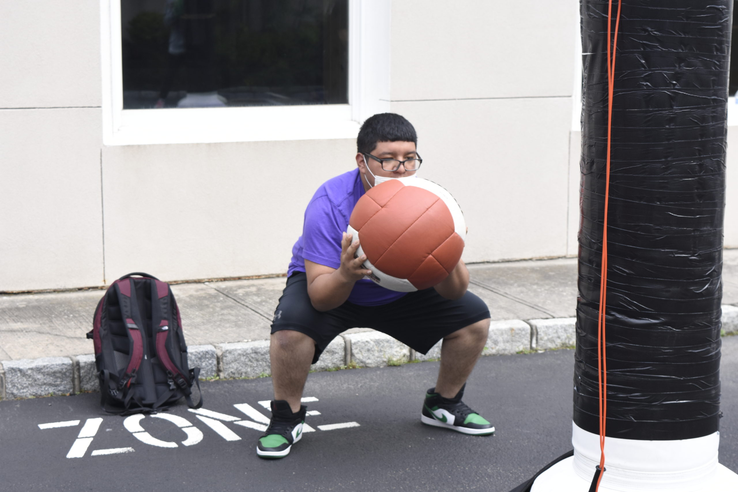 Alexander Franco works out with a medicine ball at Hill Street Boxing on Friday.