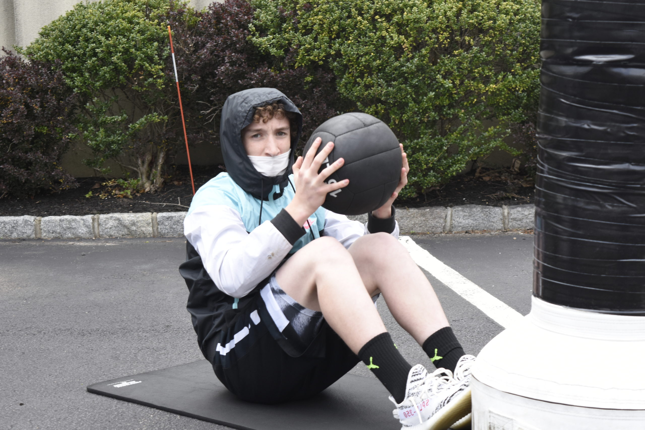 Chandler Tuttle works out with a medicine ball at Hill Street Boxing on Friday.
