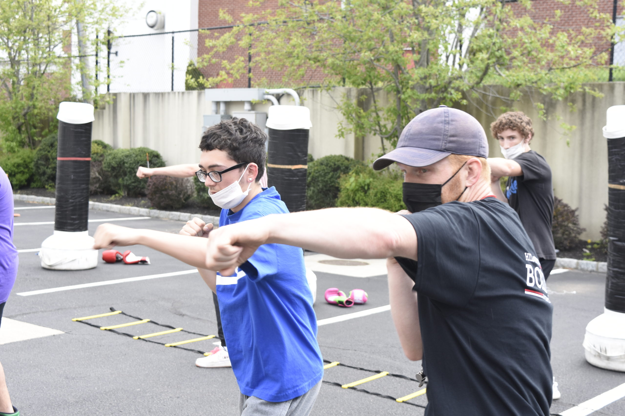 Avery Crocker, right, shows Tim McCarthy  how to correctly throw a jab.