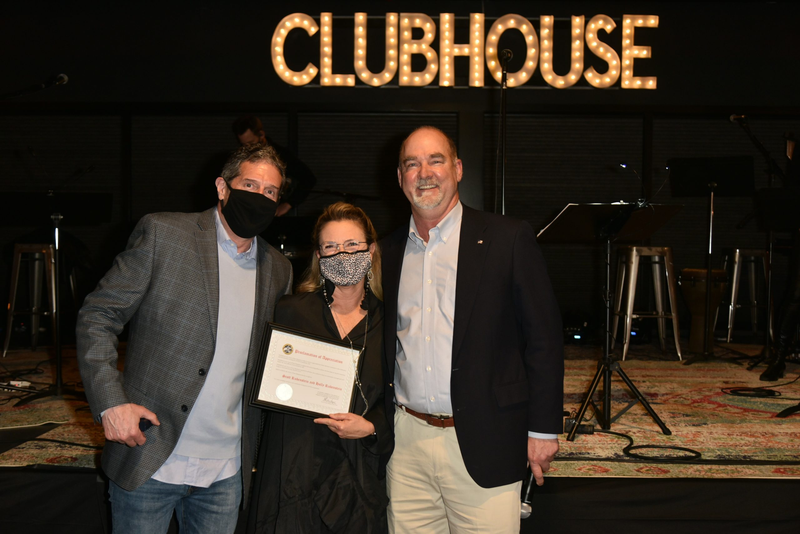 The Clubhouse owners, Scott and Holly Rubenstein, being honored by Supervisior Peter Van Scoyoc for their work supporting the JBJ Soul Kitchen, Meals on Wheels and Project Most.