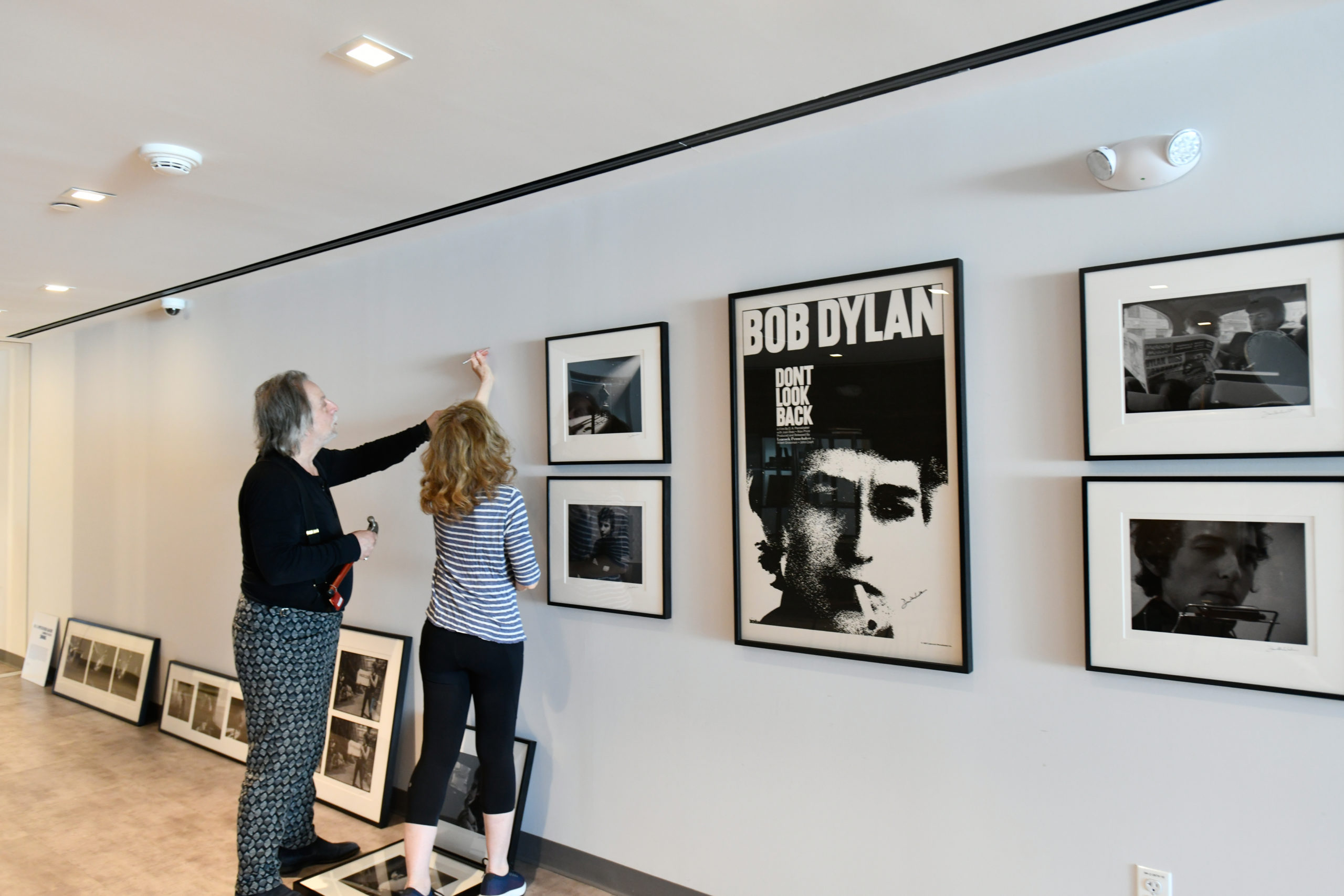 Joseph Baldassare, proprietor of Arthouse 18, and April Gornik hang stills from the film