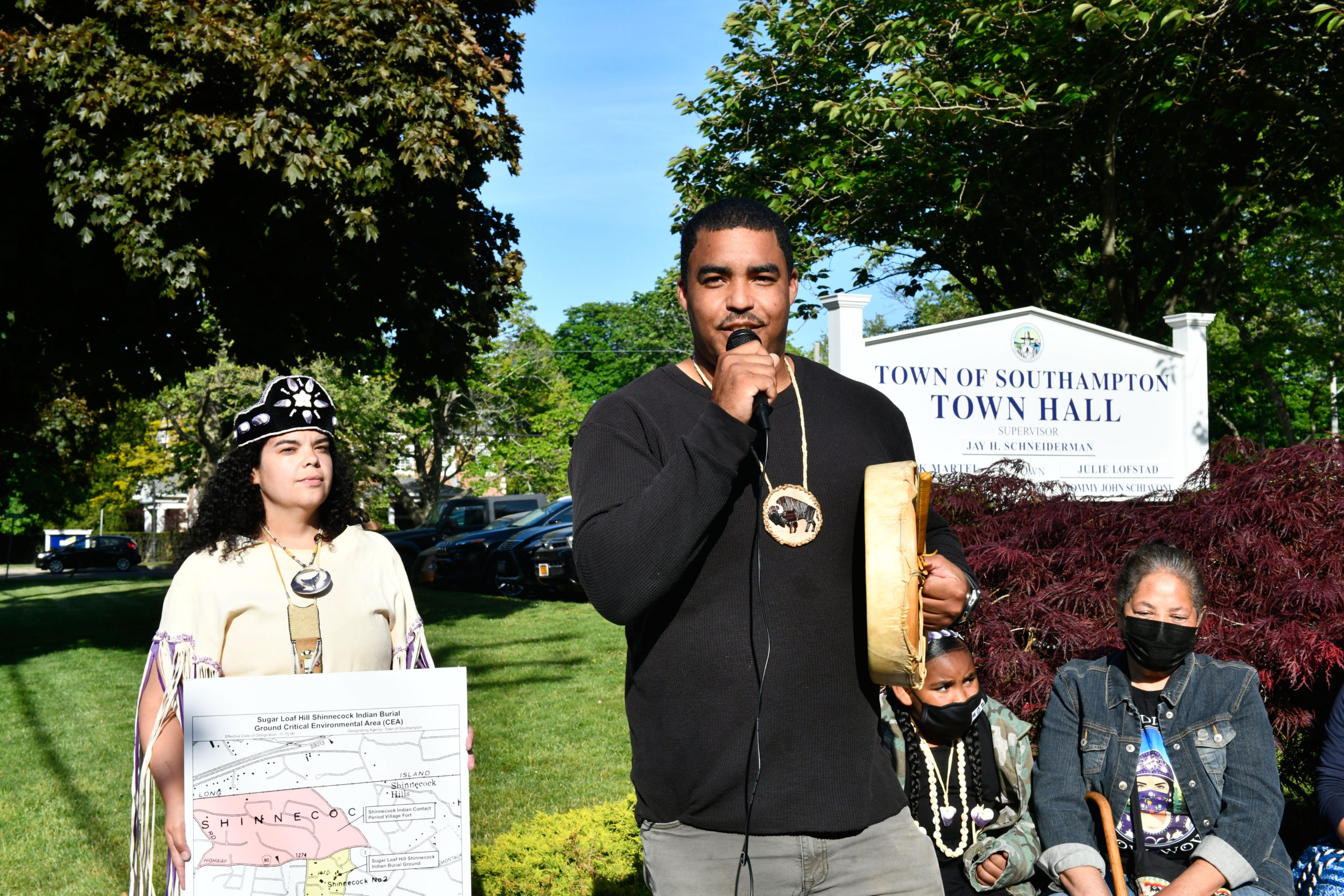 Tela Troge, Shane Week and Rebecca Genia at a rally in front of Southampton Town Hall on Tuesday evening.  DANA SHAW