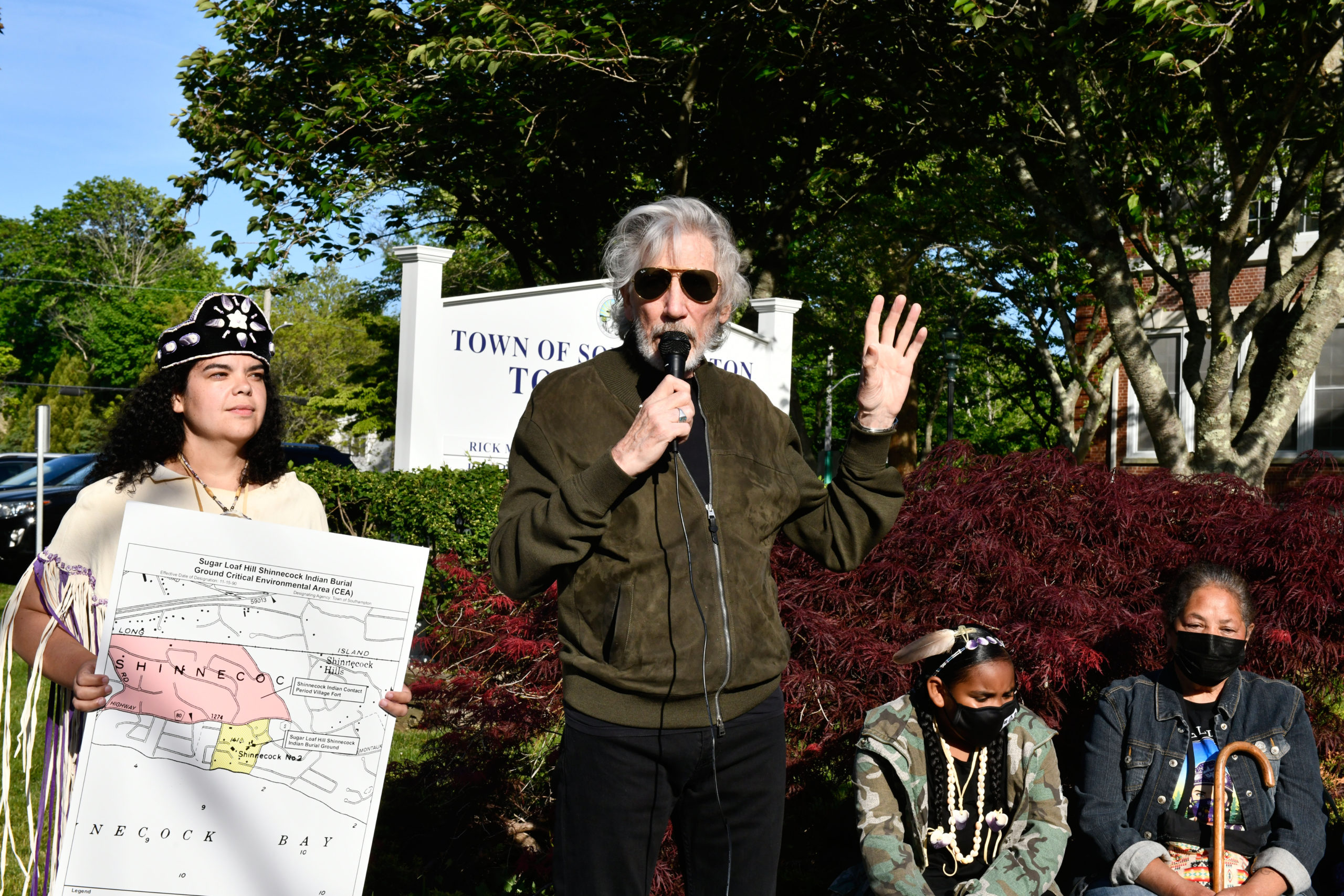 Roger Waters speaks in front of Southampton Town Hall on Tuesday evening prior to the meeting as Tela Troge, left and Rebecca Genia, right, look on.    DANA SHAW