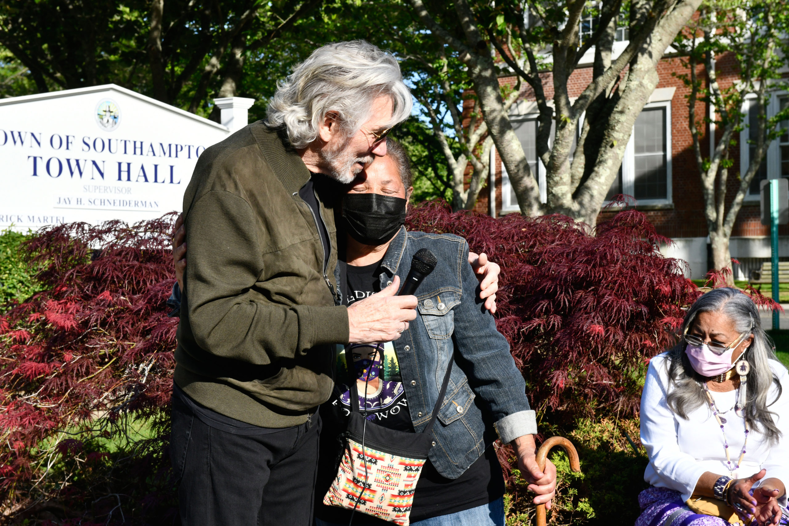 Roger Waters hugs Rebecca Genia at a rally in front of Southampton Town Hall on Tuesday evening.    DANA SHAW