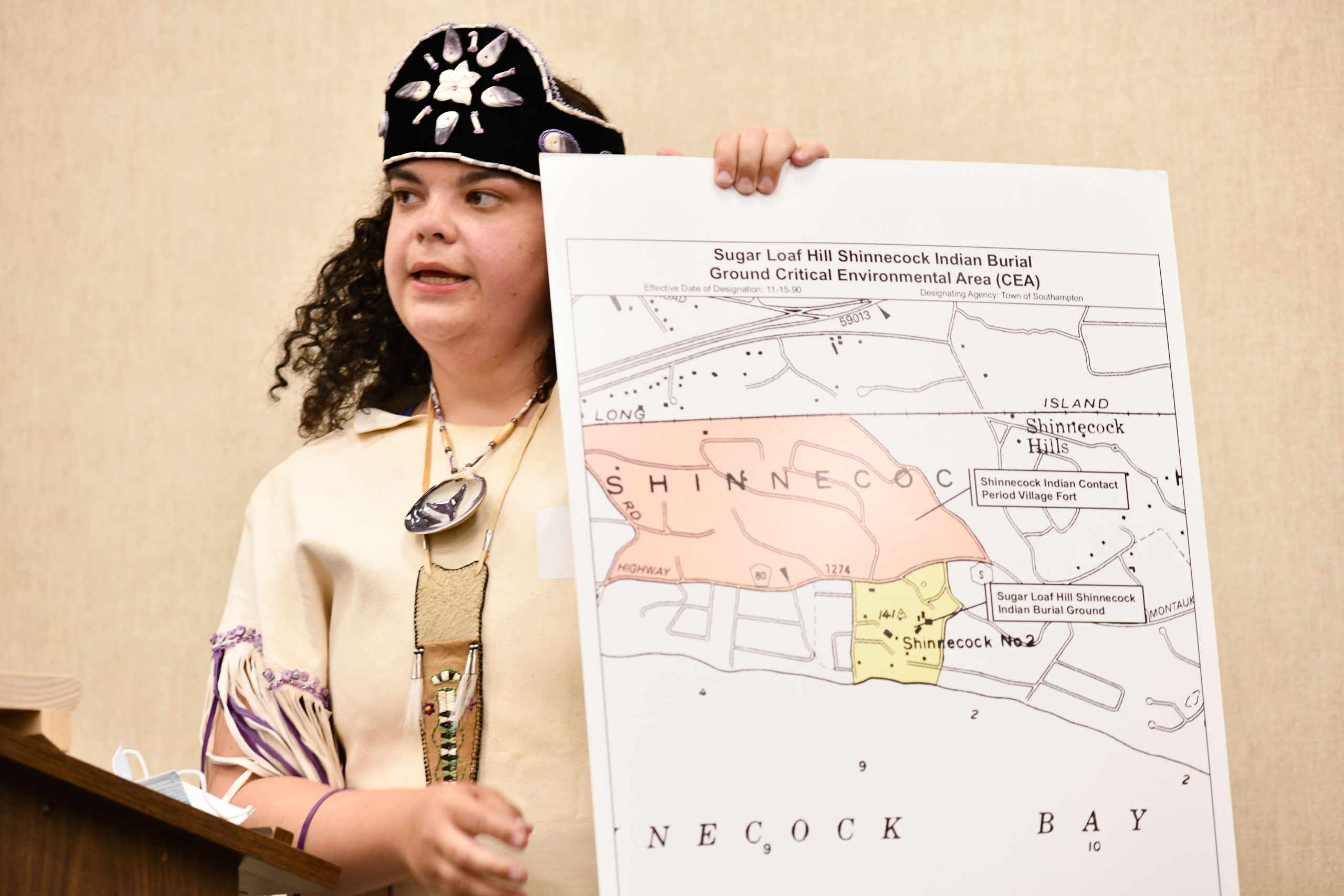 Tela Troge with a map that shows the area in question.  DANA SHAW