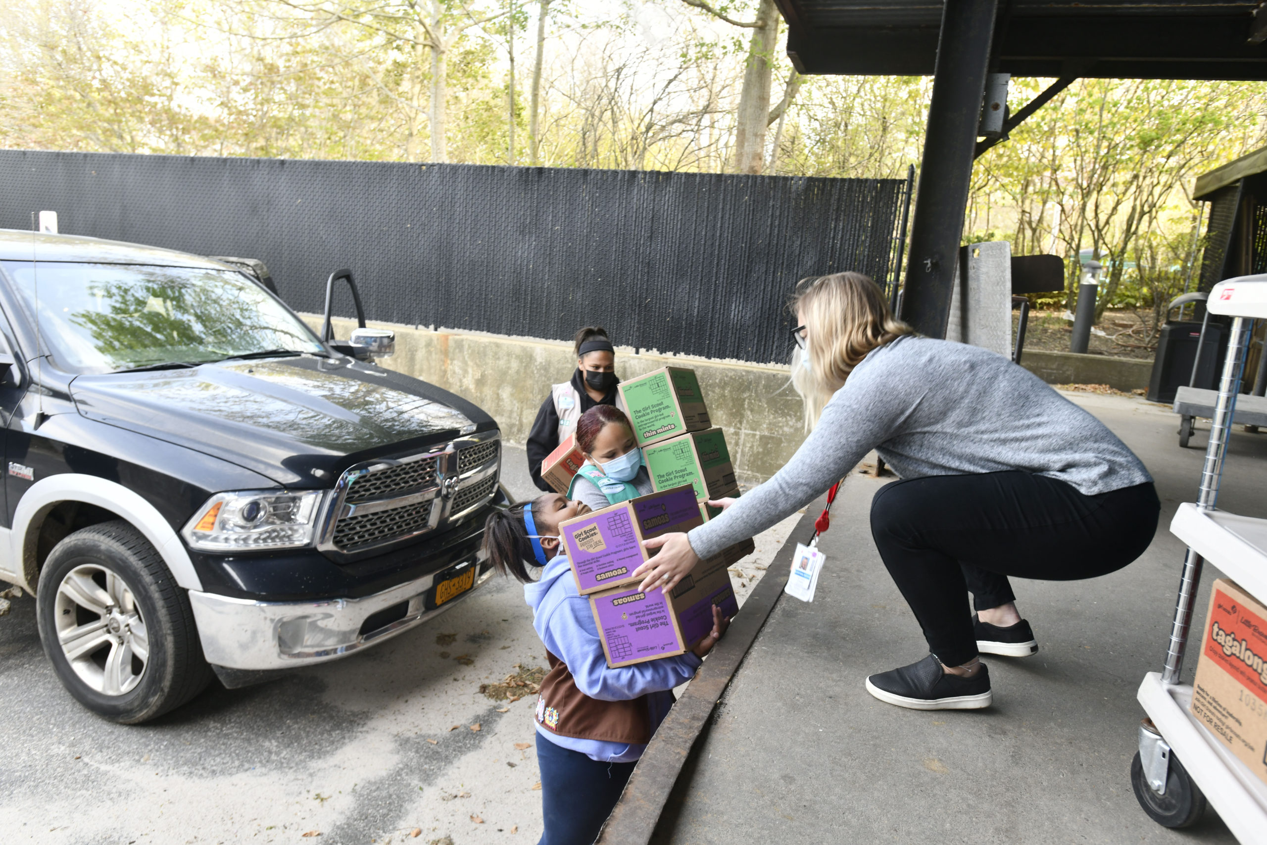 Members of Girl Scout Troop 642, Gabriella Gaines, Syvana Smith and Jordyn Smith, from the Shinnecock Nation dropped off 300 boxes (25 cases) of Girls Scout Cookies for the employees at Stony Brook Southampton Hospital on Sunday afternoon.  DANA SHAW