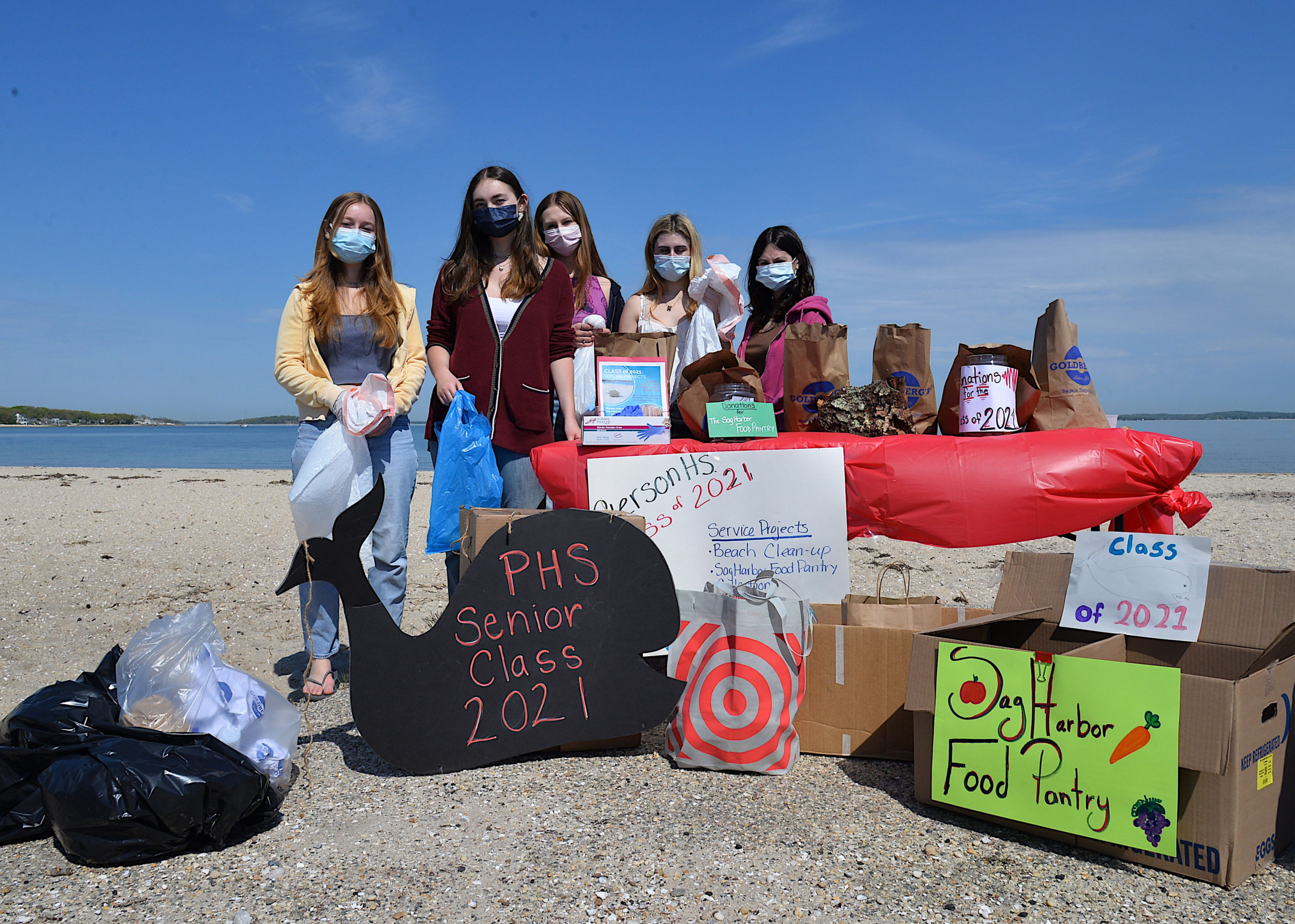 Pierson seniors Francesca Vitale, Jamie Farnam, Tess Norris, Sarah Van Houten and Emily Brownstein at Long Beach on Sunday morning for beach clean up and food pantry donations.  KYRIL BROMLEY