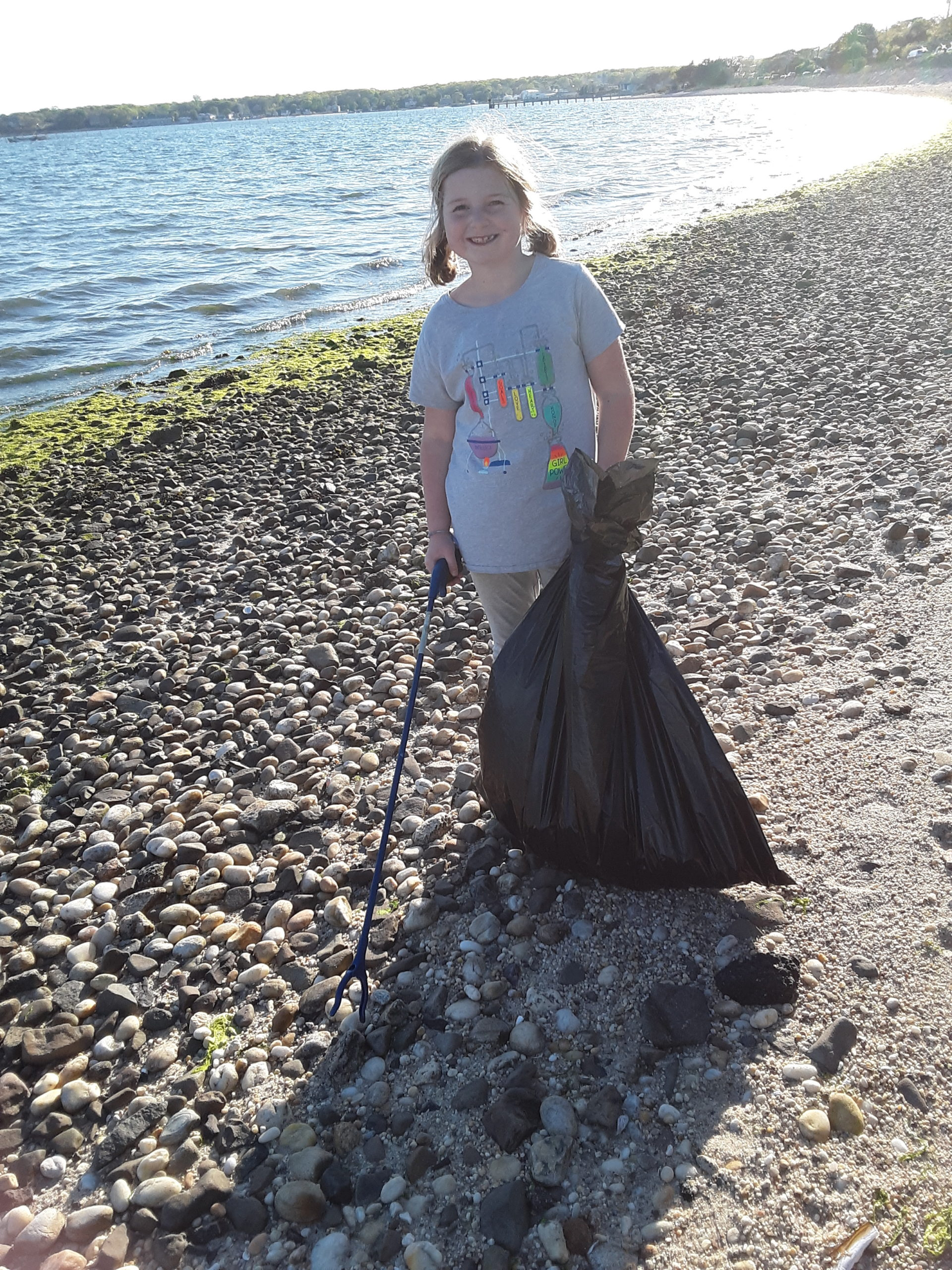 For the second year, Kay Dupree, a third grader at Southampton Elementary School, helped her grandmother clean up the Peconic Road/Shinnecock bay beach as a part of the Great East End Cleanup.