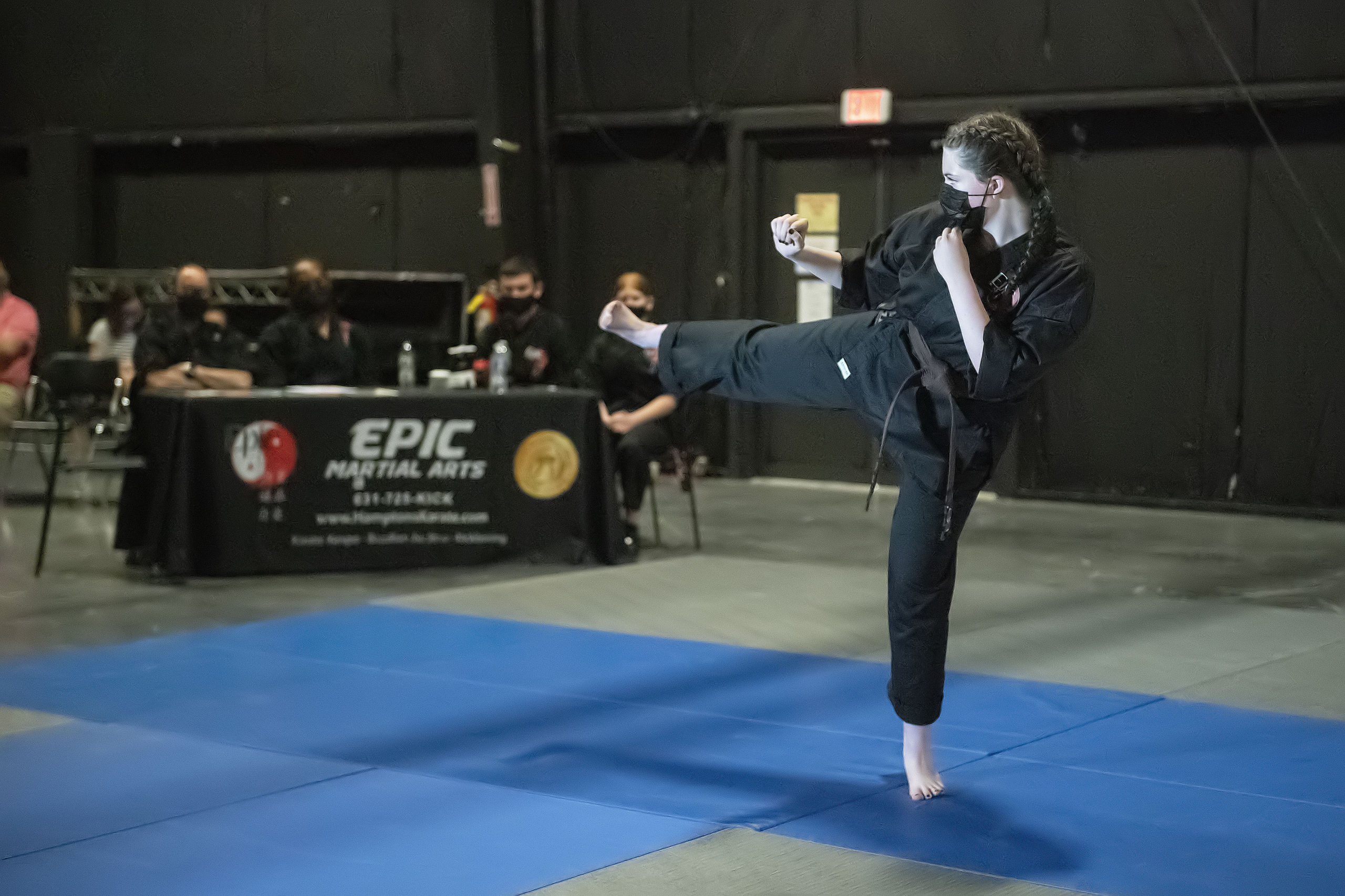 EPIC Martial Arts brown belt student Emily Glass performs a series of skills before a panel of six black belts in order to receive her own promotion to black belt during a ceremony at LTV studios in Wainscott on Sunday.