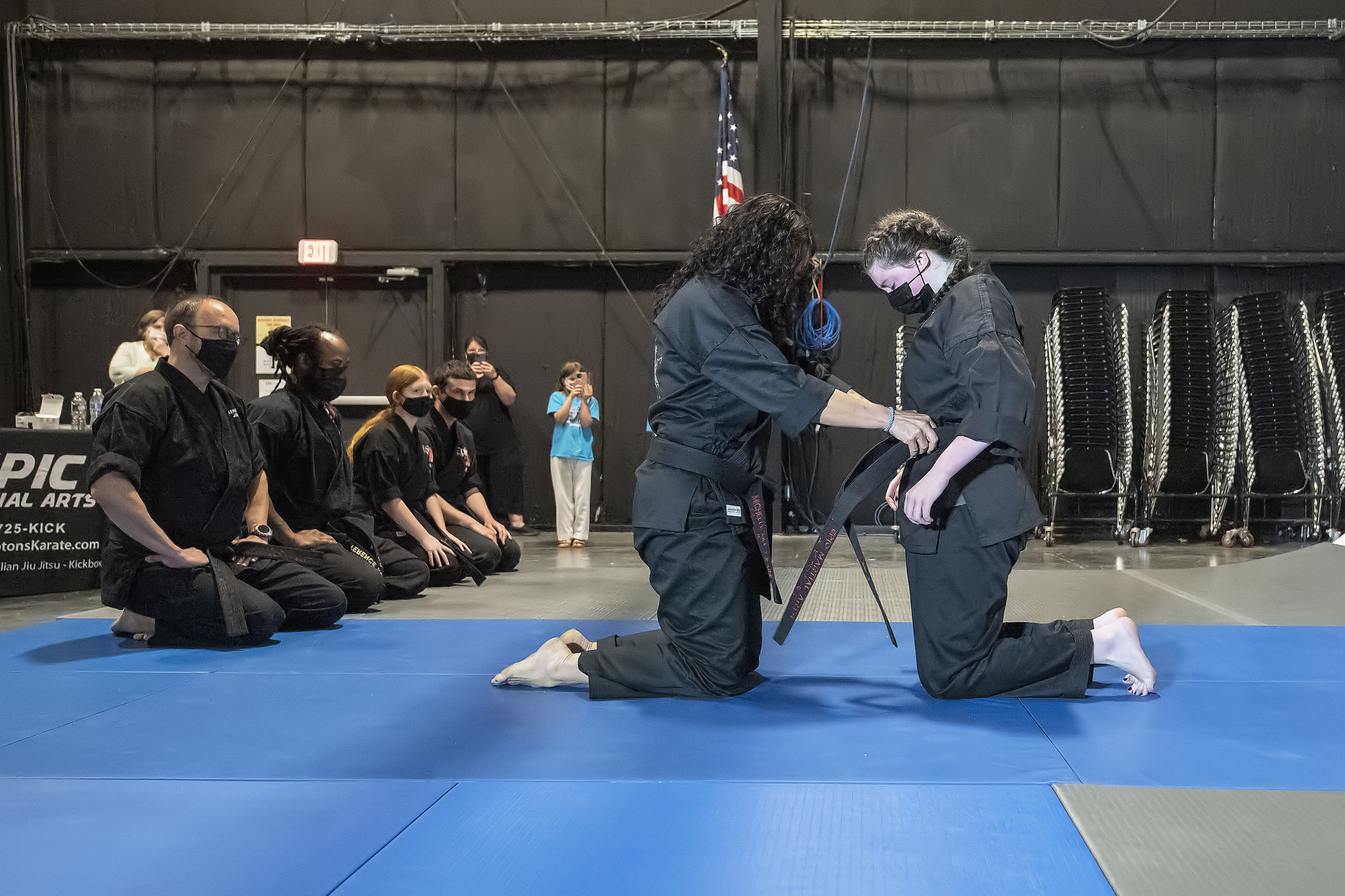 Emily Glass receives her black belt from EPIC Martial Arts Instructor Michelle Del Giorno.