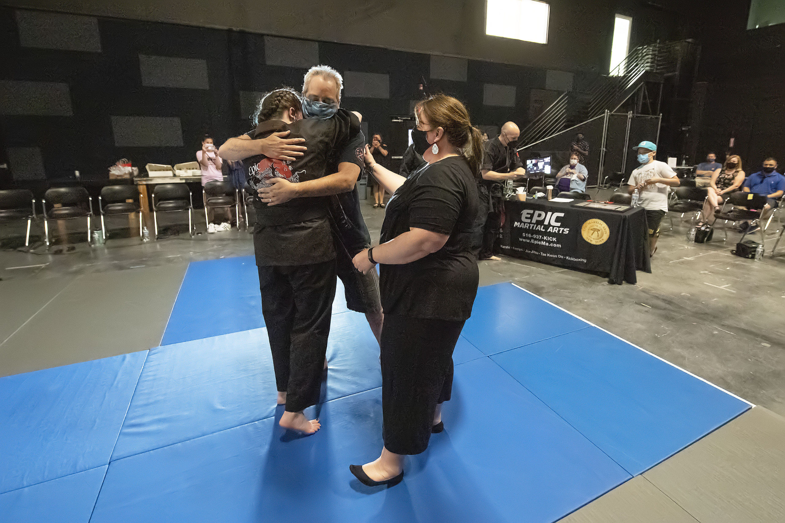 Emily Glass with her parents Jennifer and Dan Glass after receiving her black belt on Sunday.