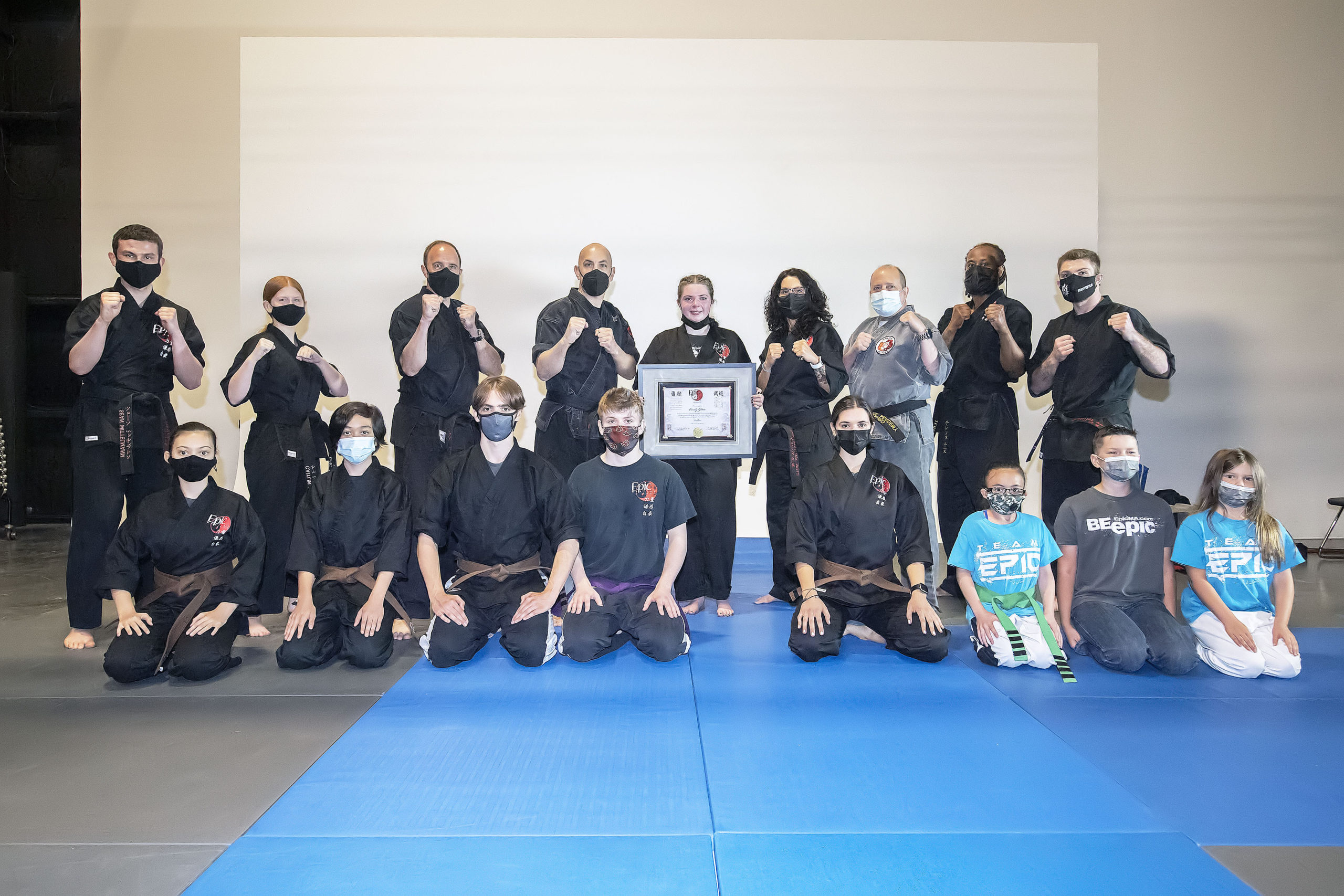 Emily Glass with instructors and other members of EPIC Martial Arts.