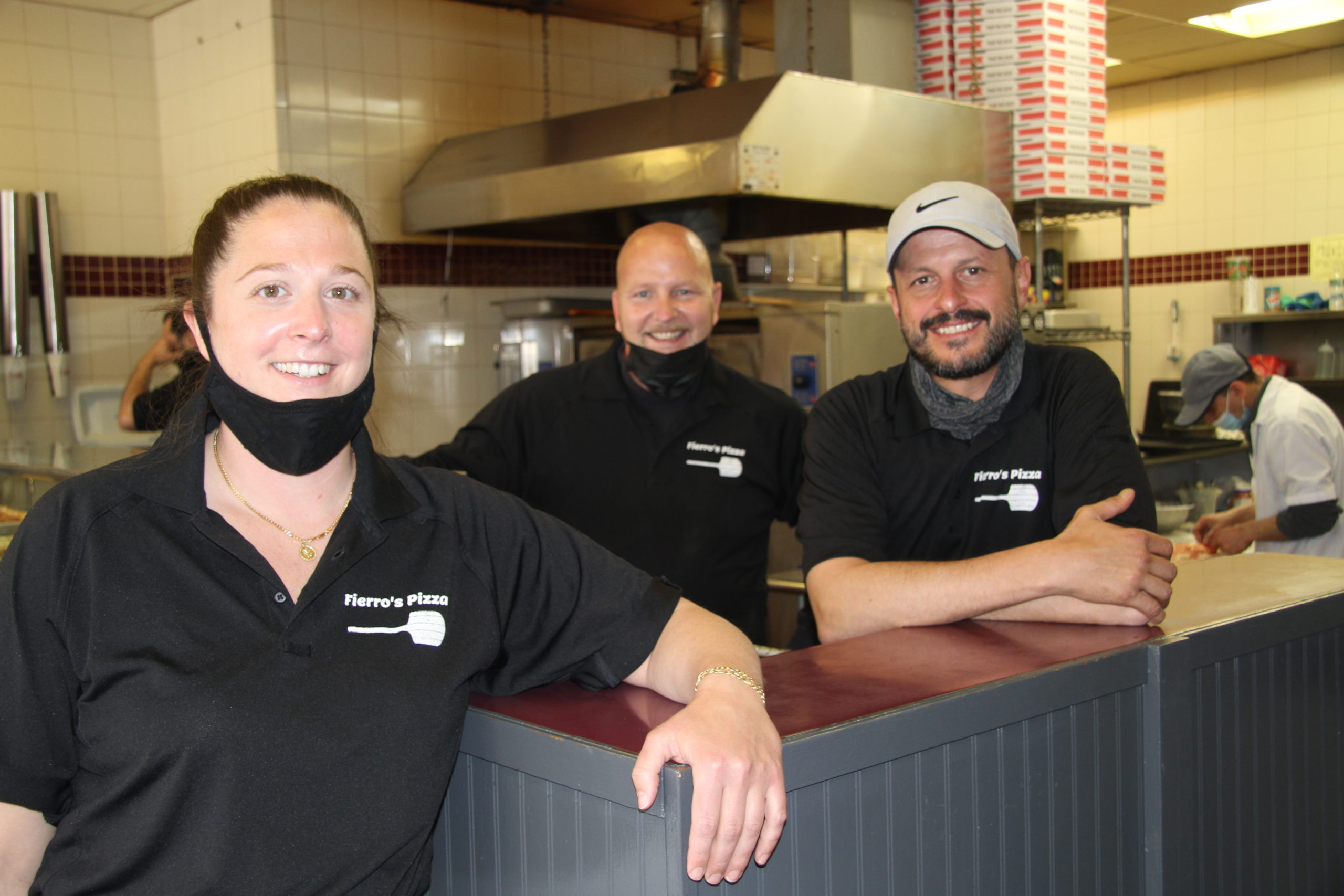 Fiero's Pizza co-owner Steve Hickey, rear, officially has two new partners this week: East Hampton natives Emma Beudert and Joe Kastrati.