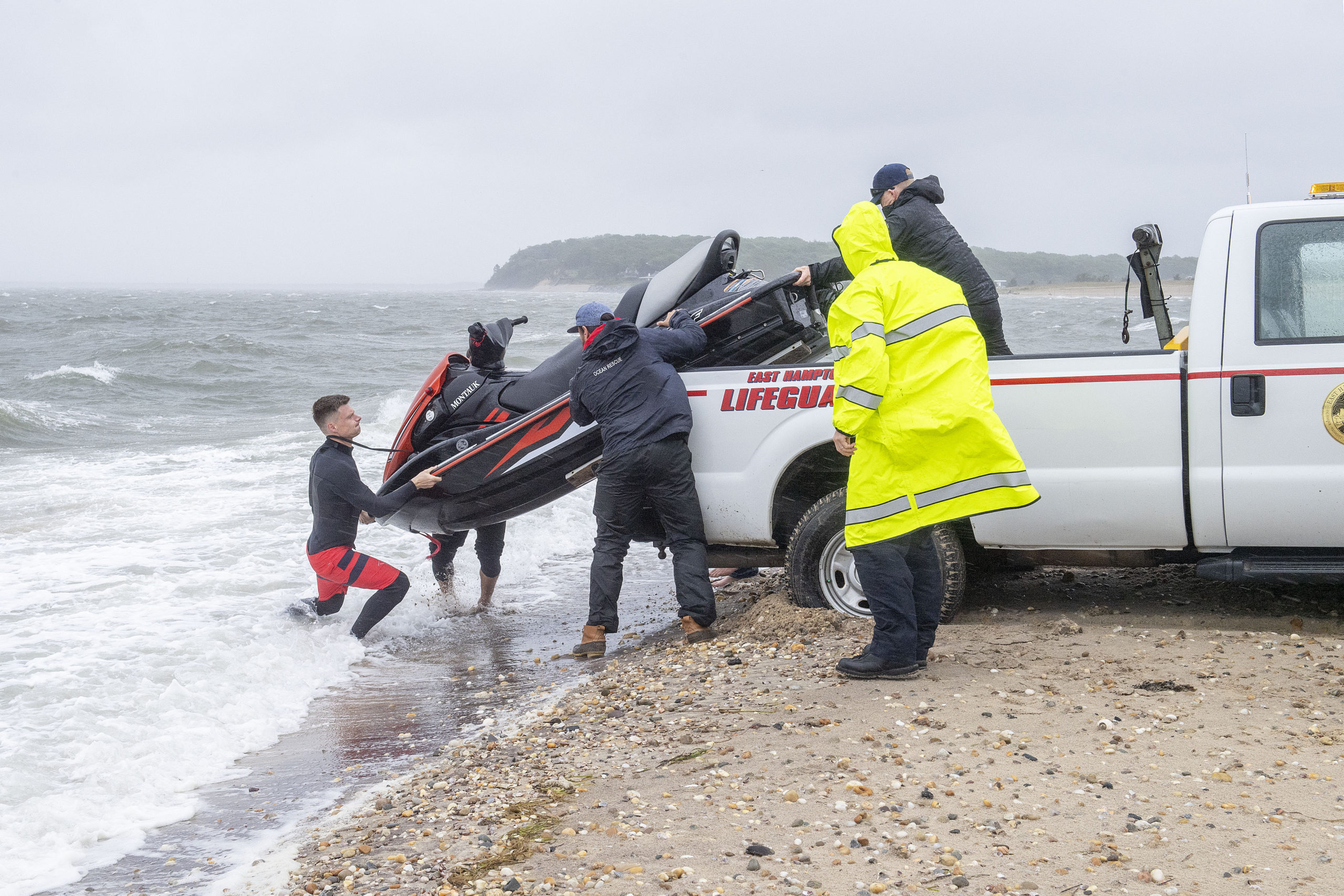 Members of the East Hampton Ocean Rescue Team used a jetski and sled to help with rescuing two kiteboarders who were caught out in the gale-force winds and rough waters east of Gerard Drive in Springs.