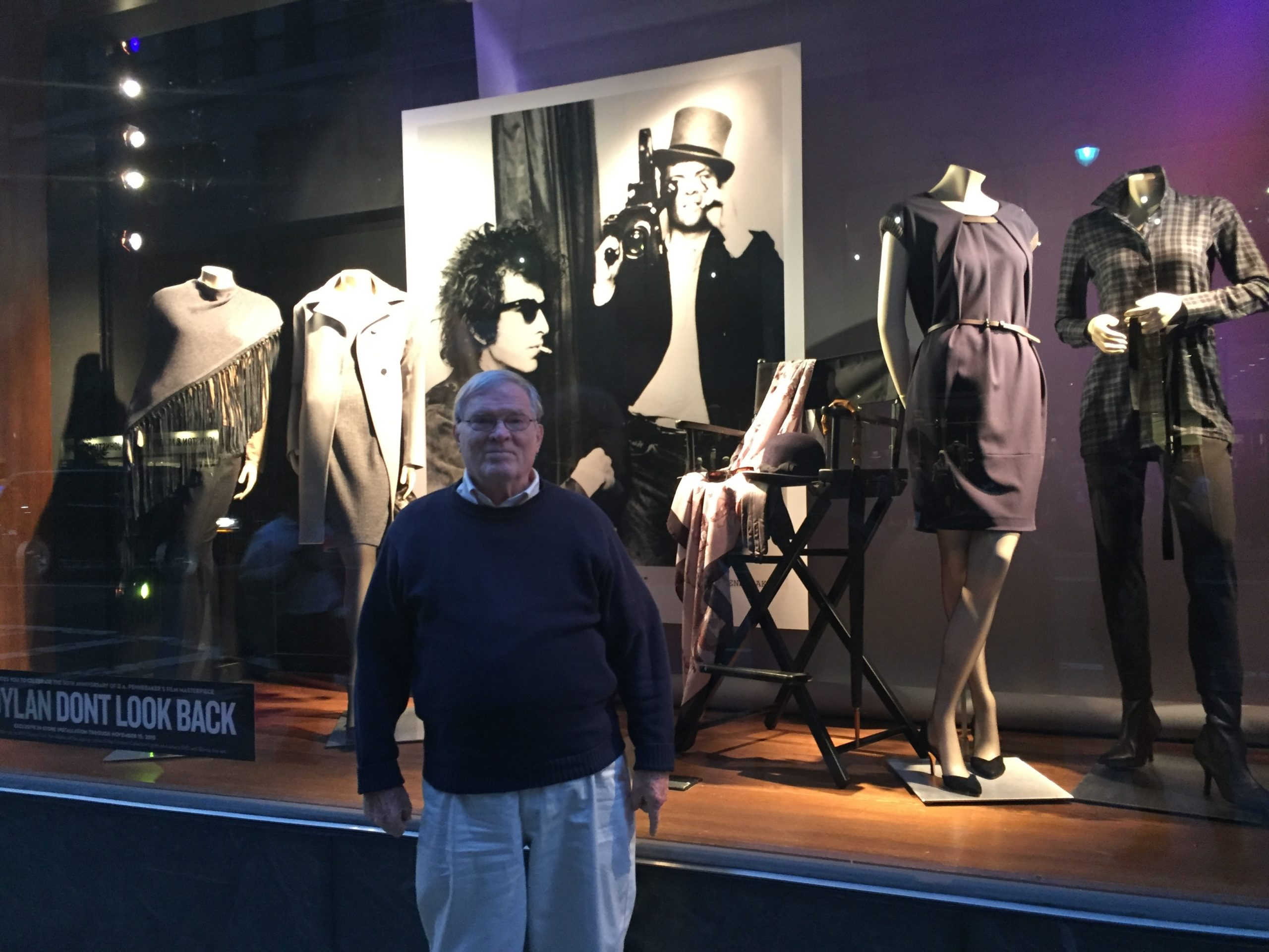 D.A. Pennebaker in front of the Paul Stuart store window on Madison Ave featuring Joseph's Baldassare's first Bob Dylan photo exhibition. installed