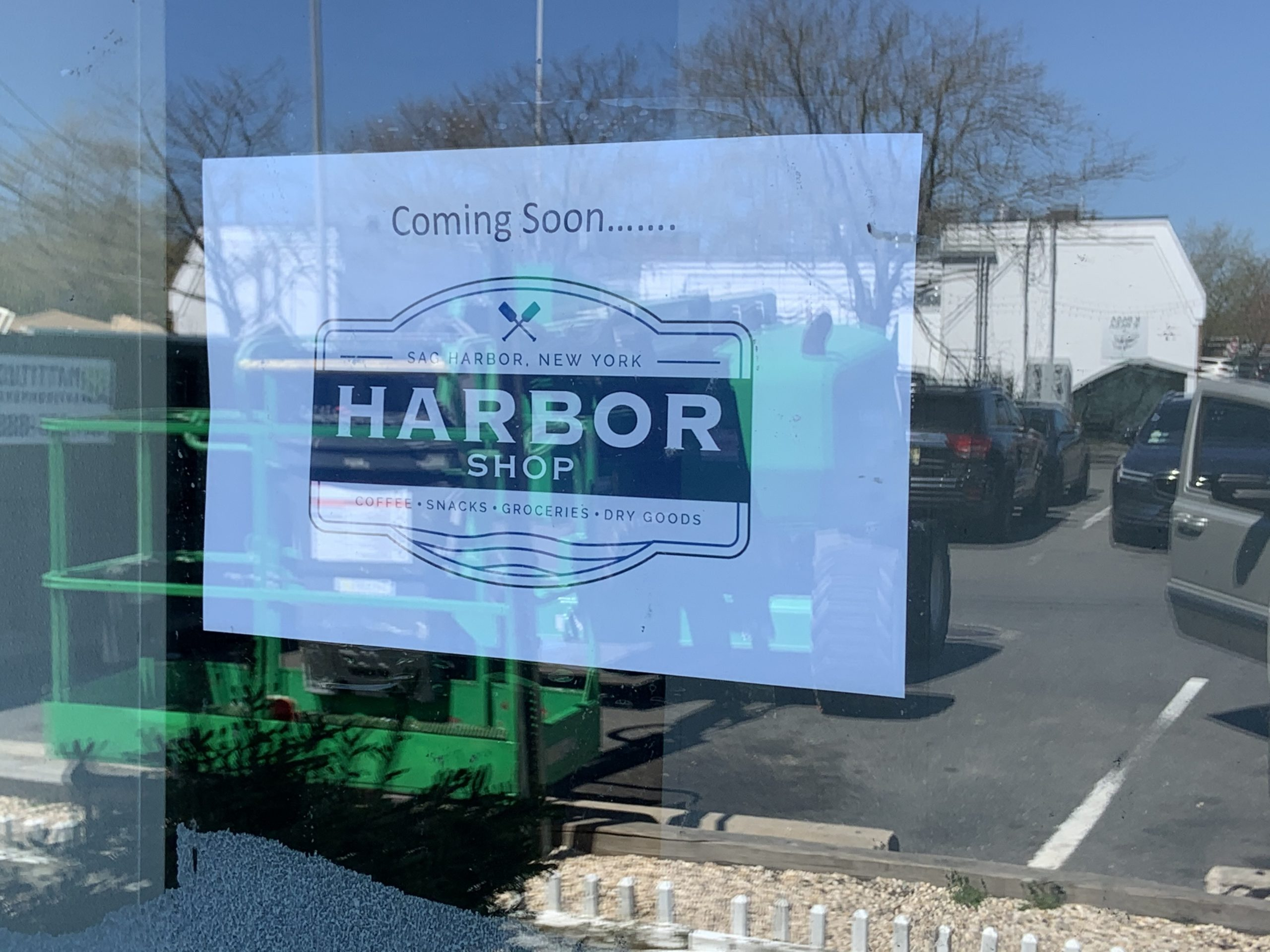 Signs announce the arrival of a new convenience store in the space formerly occupied by 7-Eleven in Sag Harbor.  STEPHEN J. KOTZ