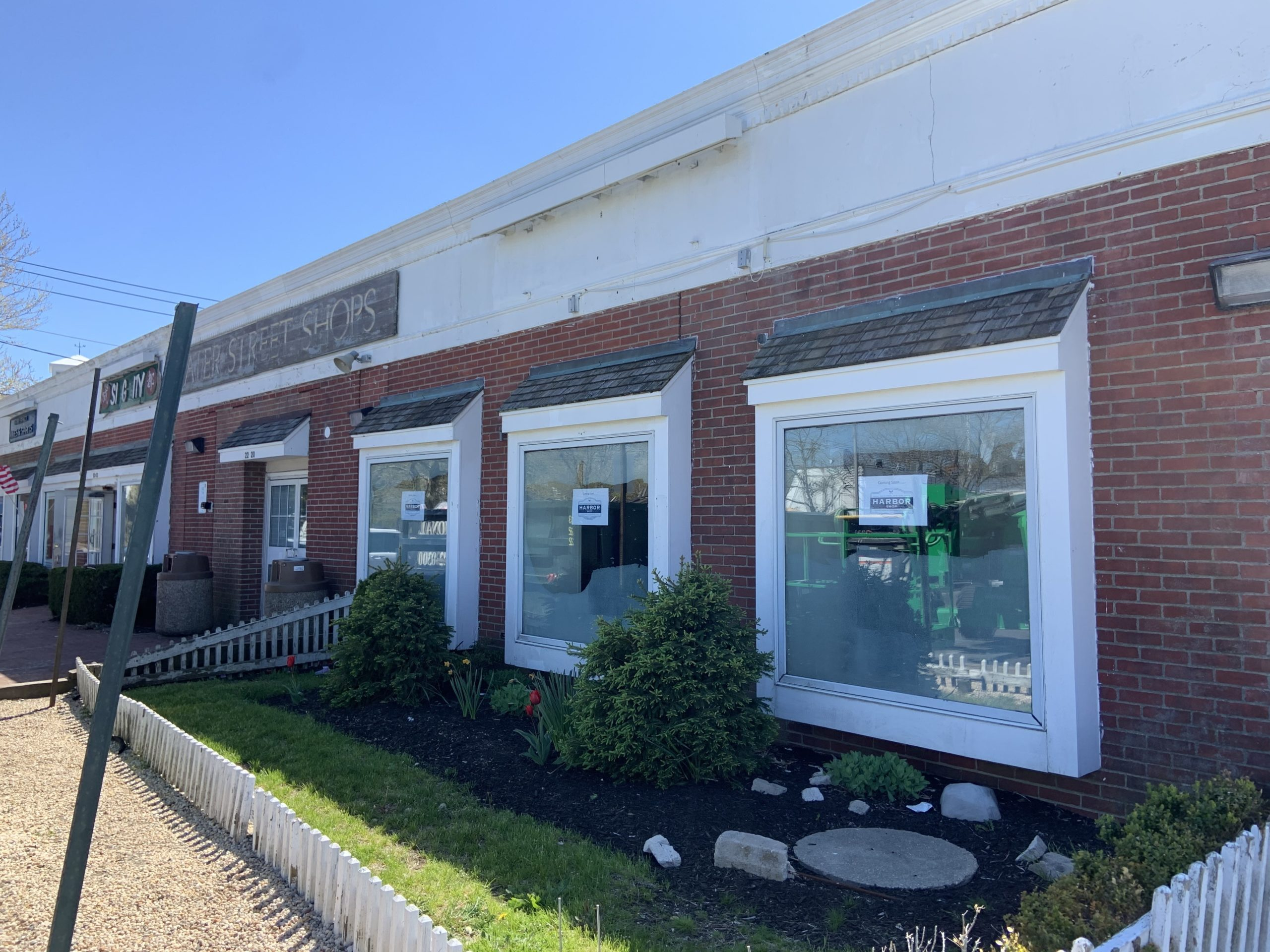 Signs in the window announce a new convenience store in the space formerly occupied by 7-Eleven in Sag Harbor. STEPHEN J. KOTZ