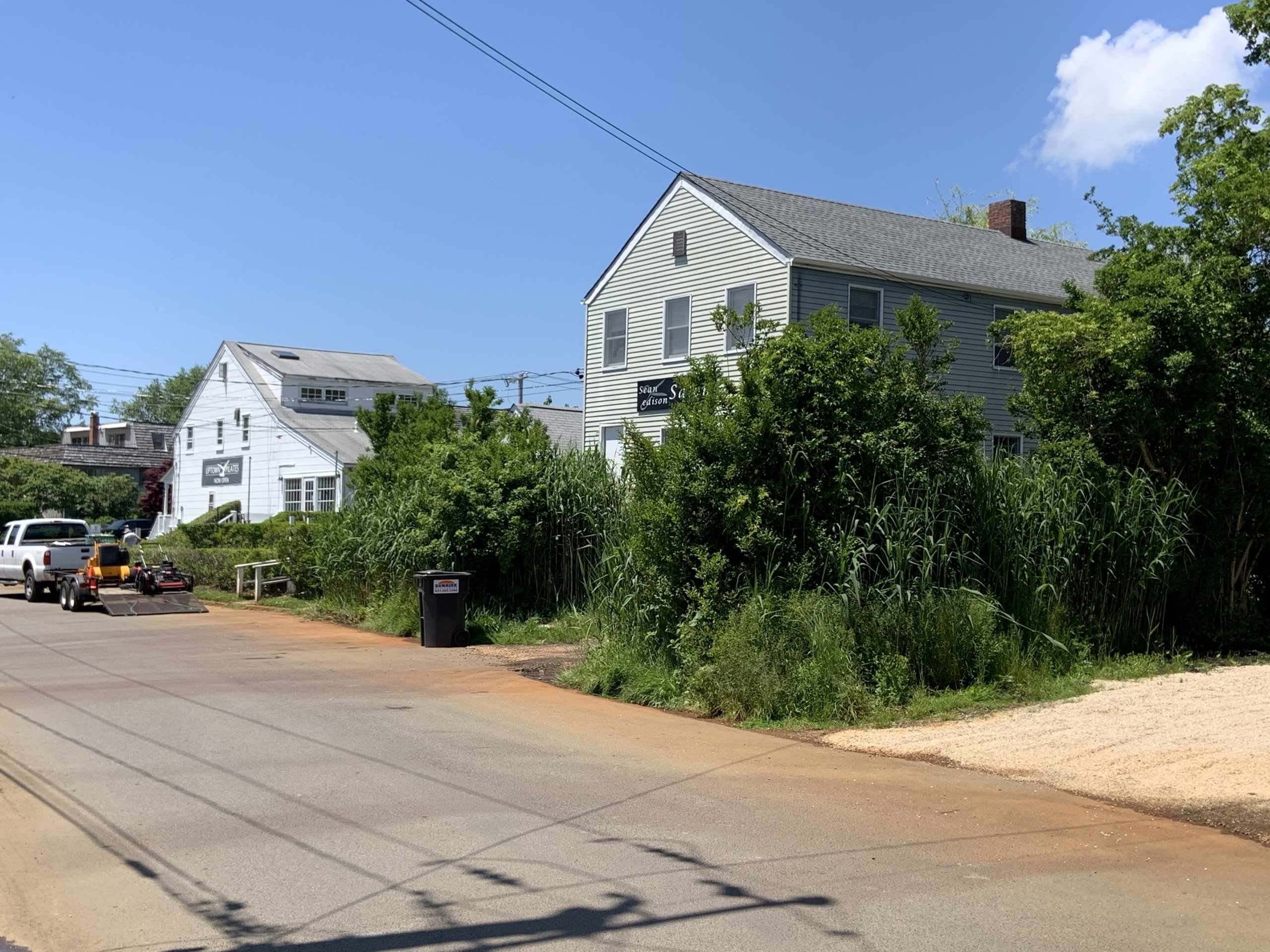 Most of the property in the Office District, including these buildings on low-lying Rose Street, will be dropped from the area being considered for rezone in a Waterfront Overlay District in Sag Harbor. STEPHEN J. KOTZ