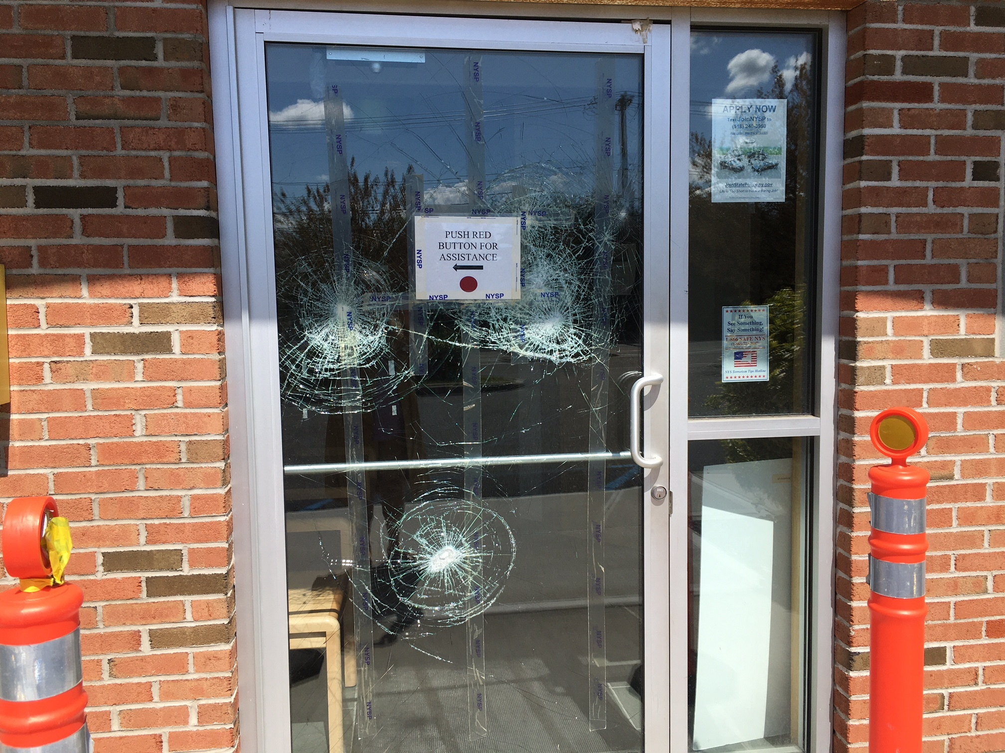 Community members  complained of 'bullet holes' in the door and windows at the State Trooper barracks in Riverside.
