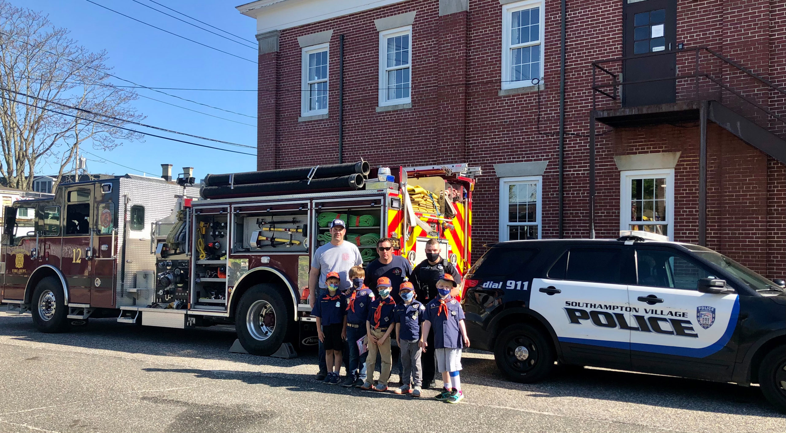 Cub Scout Pack 14 Tiger Den visited with members of Southampton Fire Department, Southampton Village Volunteer Ambulance, and Southampton Village Police Department on Friday to learn about the emergency services and earn the Tiger Safe and Smart achievement. Back row, left to right, Chris Capalbo, Gene Squires and Kyle McGuiness. Front row, left to right,  JT Ingram, Thomas Capalbo, Desmond O'Leary, Cole D'Italia and Tavin Tietjen.            COURTESY CHRIS CAPALBO