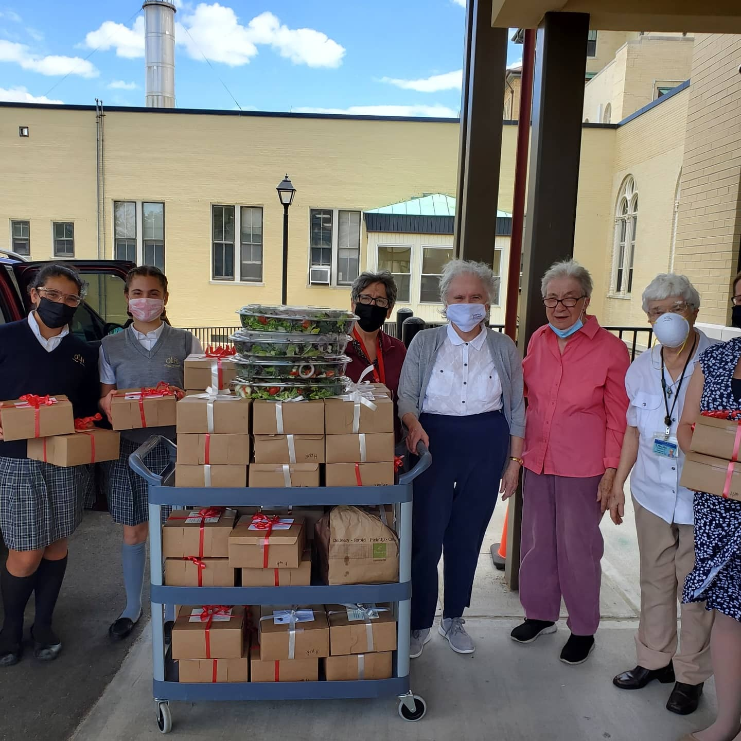 Prep 8  Maxine Boeding and Juliette Gleason delivered boxed lunches to 60 retired sisters at St. Joseph's Convent in Brentwood as a part of the Our Lady of the Hamptons Senior Luncheon.
