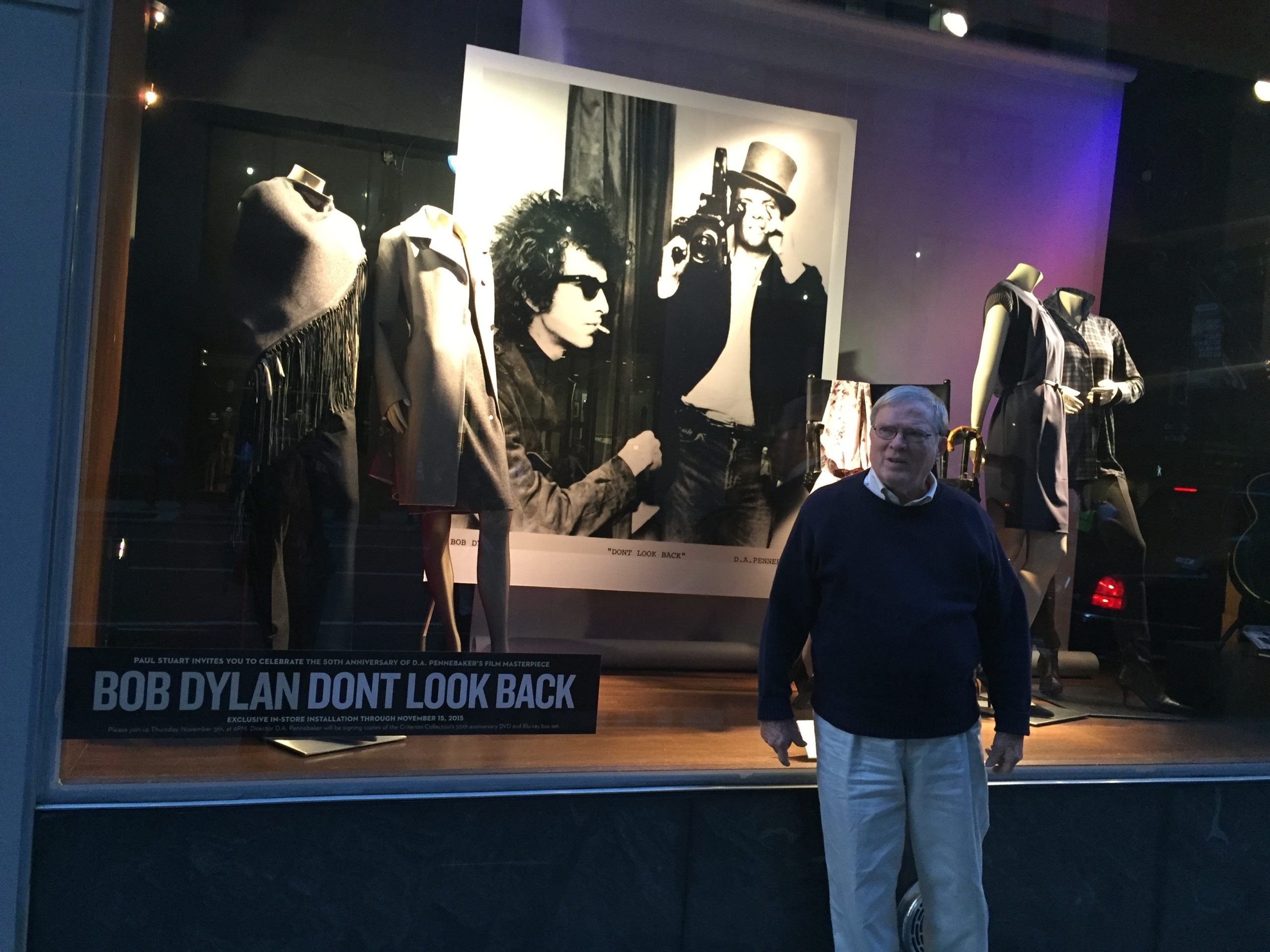 D.A. Pennebaker in front of the Paul Stuart store window on Madison Ave featuring Joseph's Baldassare's first Bob Dylan photo exhibition.
