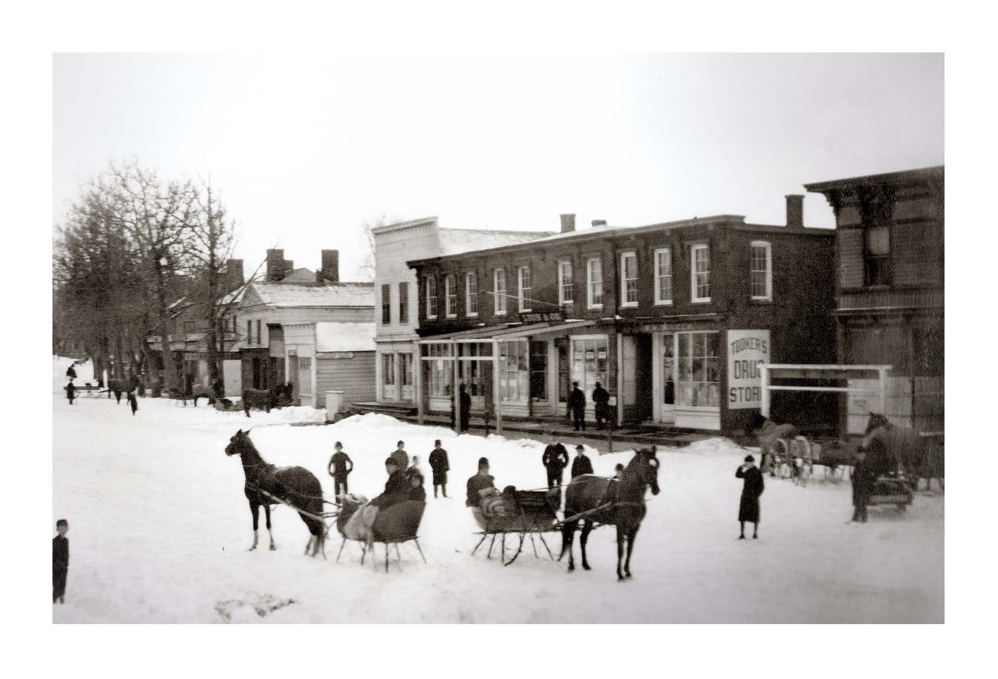 William Wallace Tooker's photo of Main Street, Sag Harbor in the snow, c. 1882. The Tooker Drugstore can be seen in the image.