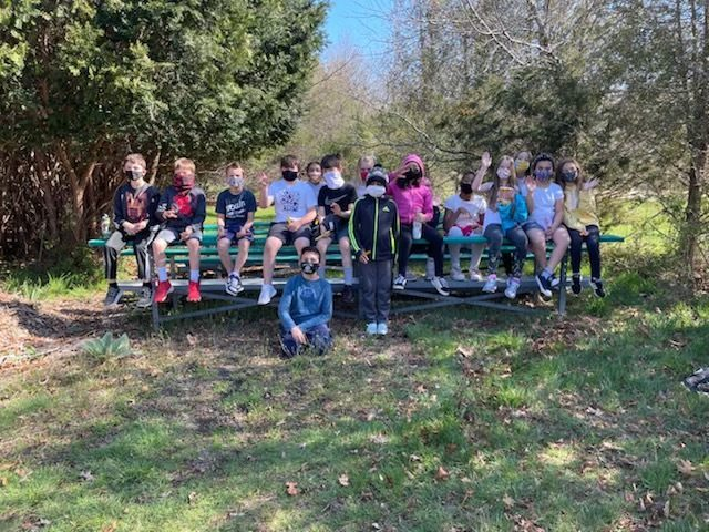 Fourth graders at Westhampton Beach Elementary School are utilizing their school's greenhouse to grow marigold plants for Mother's Day. Once the flowers are ready for picking, the students will replant them in hand-painted pots for their mothers.
