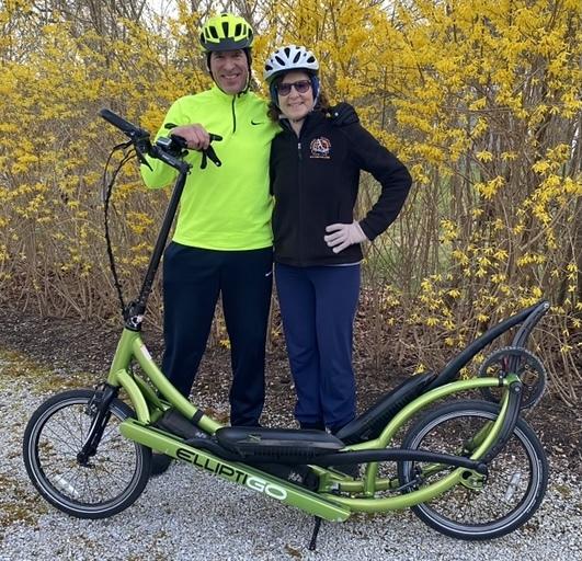 Clint and Elisa Greenbaum ride their ElliptiGOs every day.