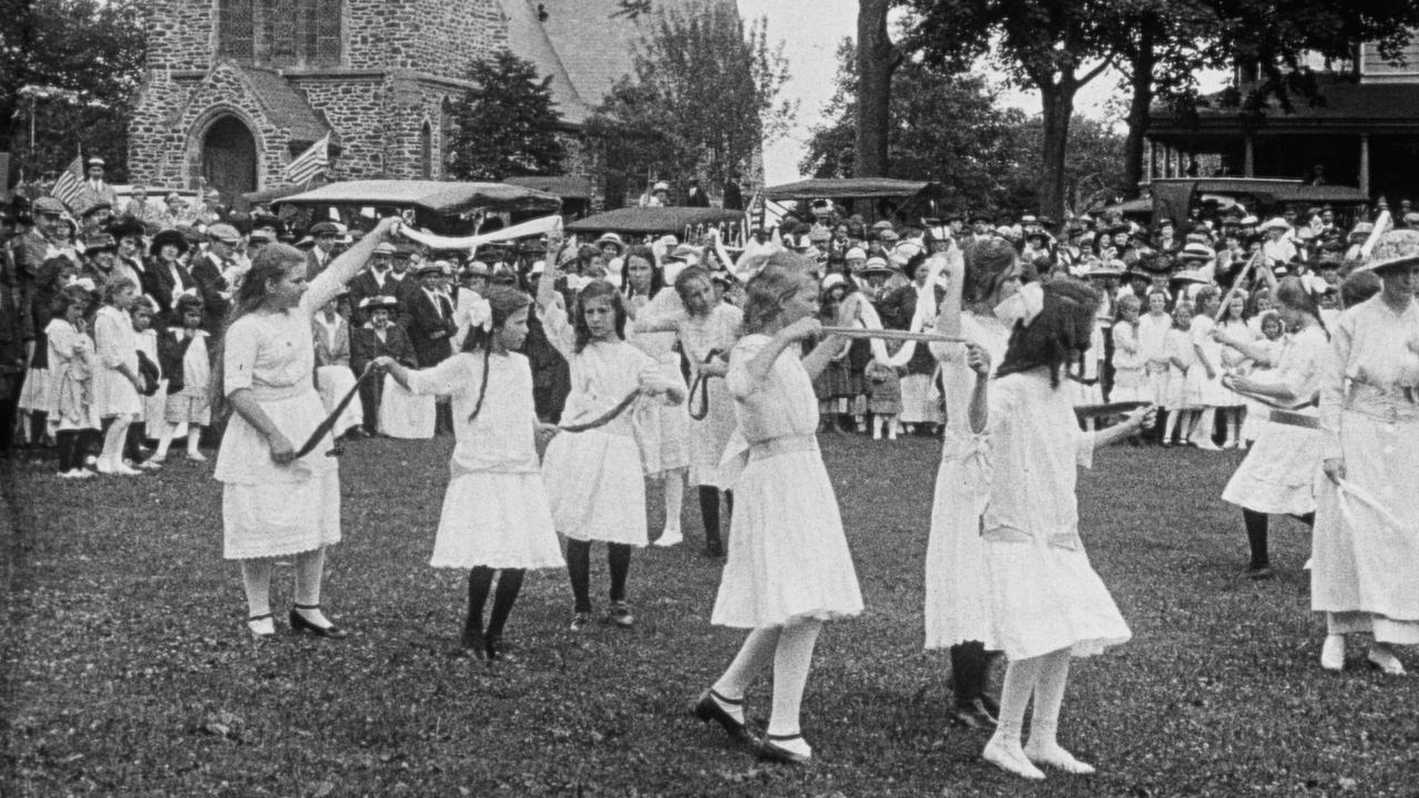 Girls dancing in front of St. Luke's Episcopal Church in Pathé News newsreel of East Hampton's 1915 Fourth of July parade.