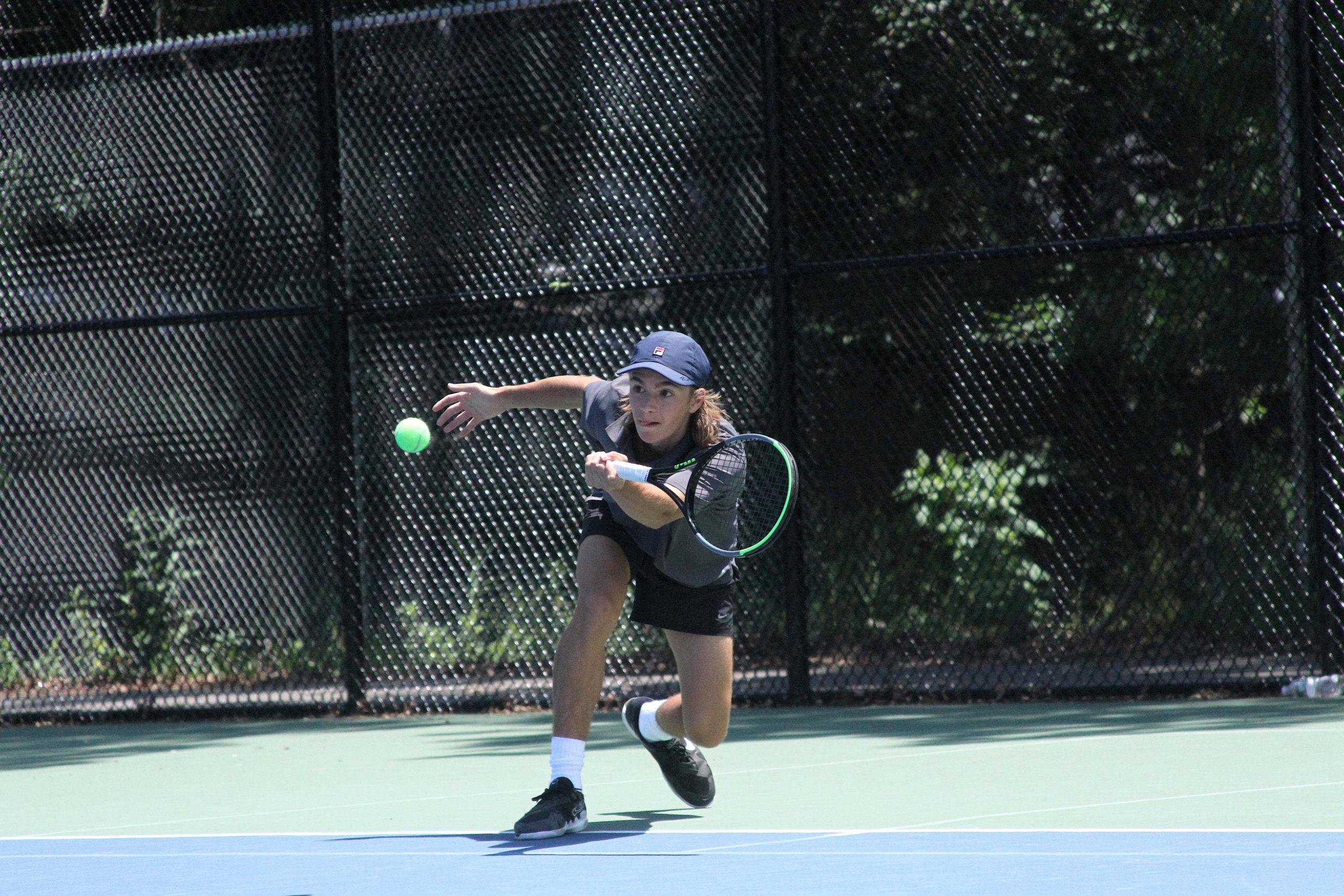 East Hampton sophomore Max Astilean returns a serve in the quarterfinals of the Suffolk County individual tennis tournament June 11. DESIRÉE KEEGAN