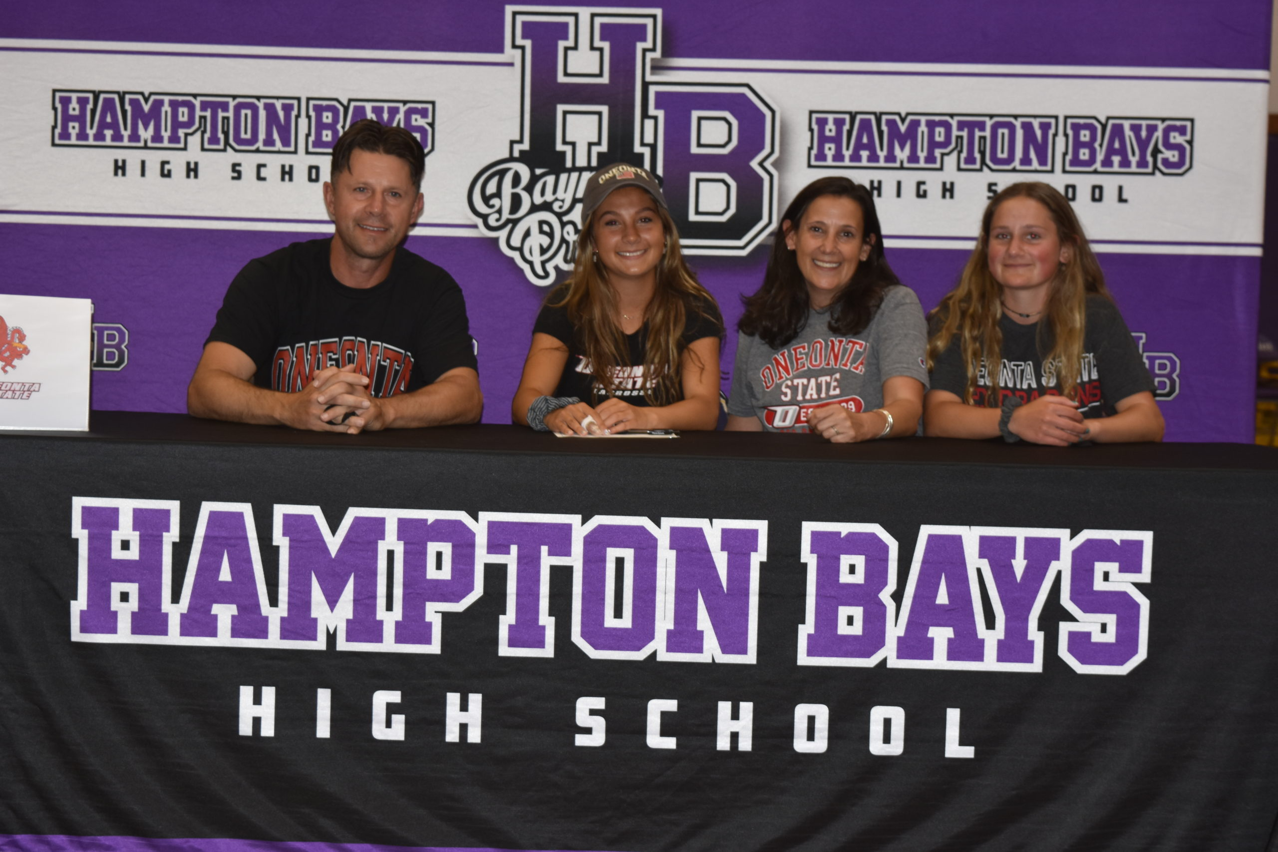From left, Vinny, Cassidy, Dawn and Jamie Moore. Cassidy Moore signed her letter of intent to play lacrosse at SUNY Oneonta on June 1.