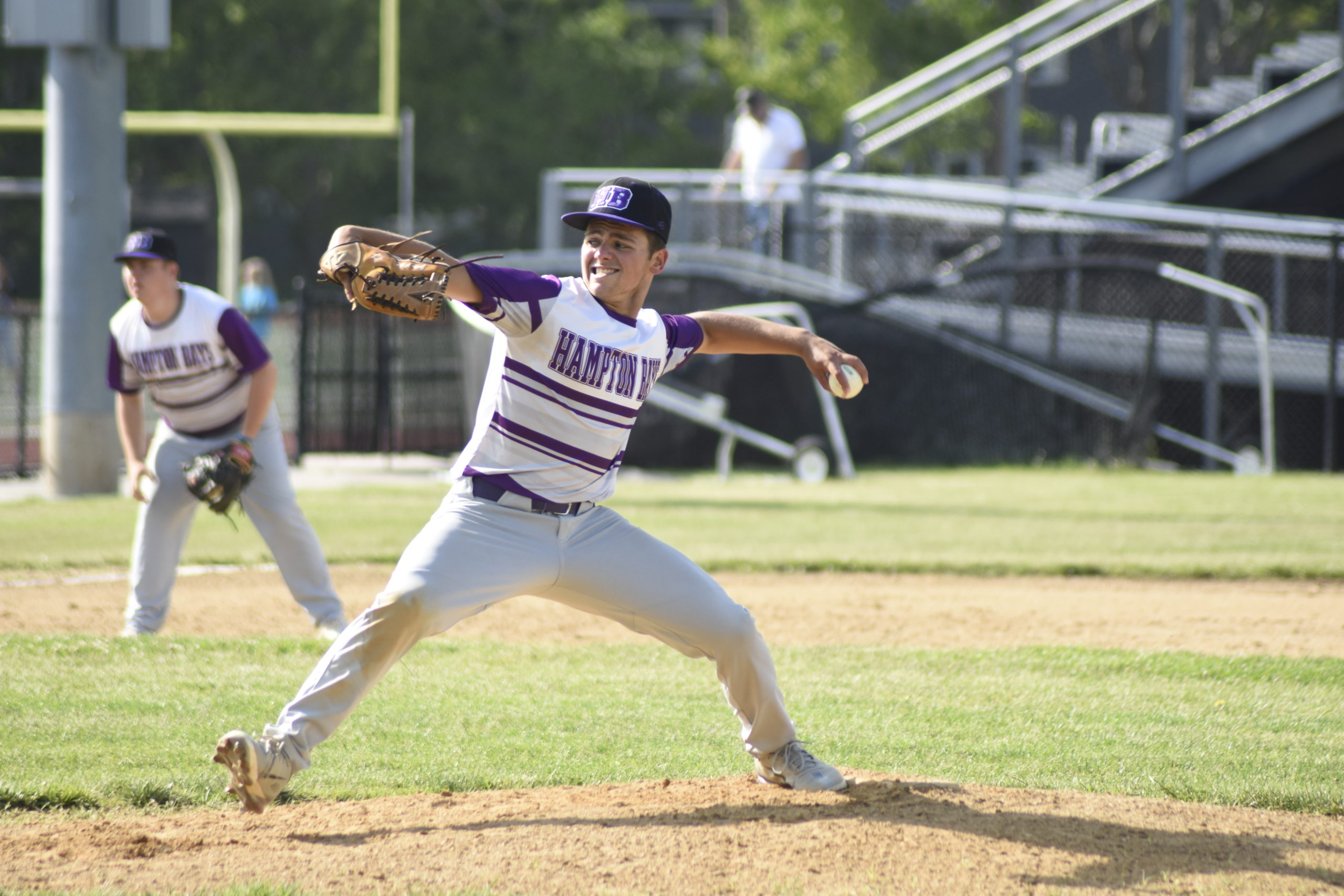 Hampton Bays senior Jordan Adelson delivers a pitch to the plate during Friday's blowout victory.