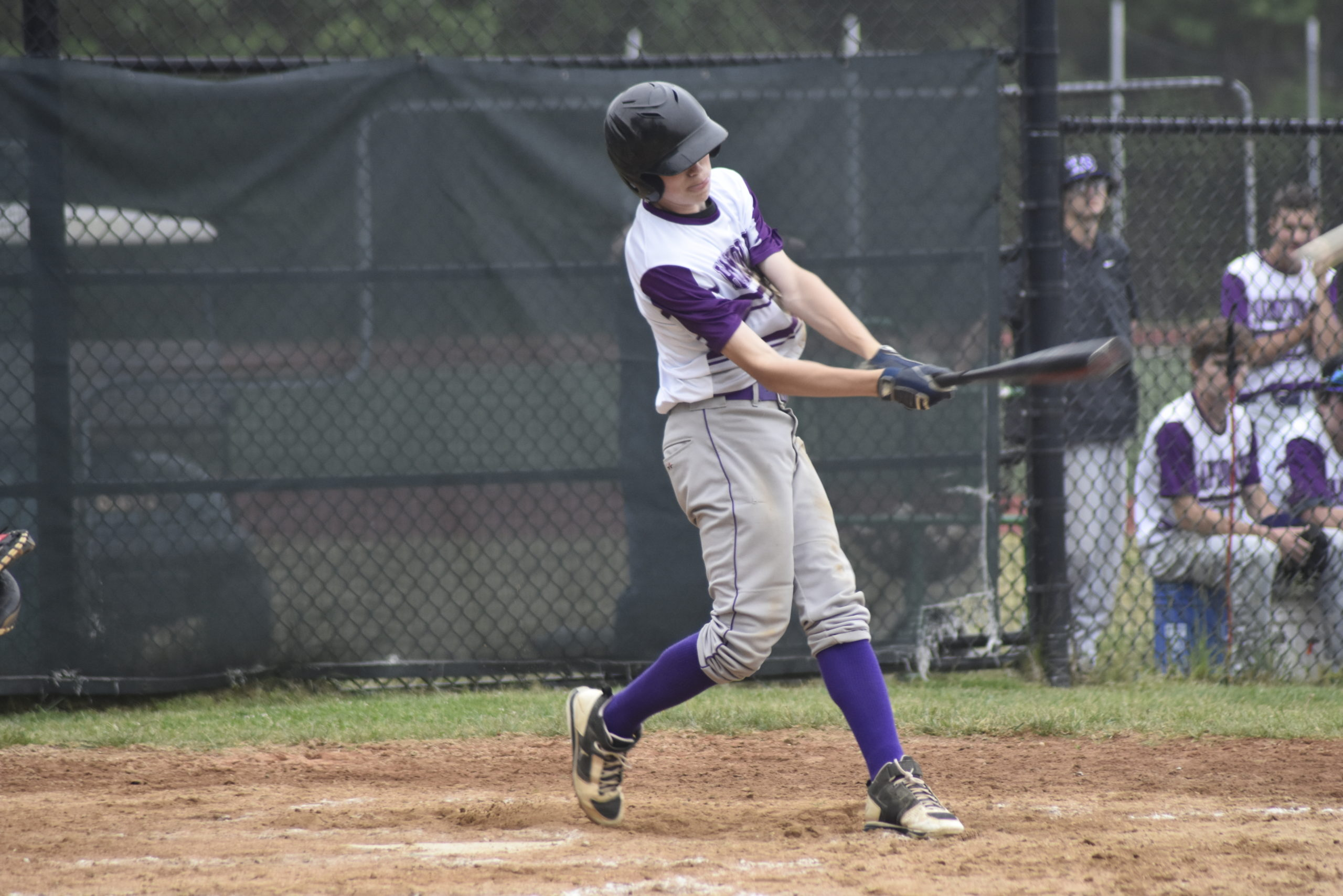 Bayman Pat Donahue launches a double into the left field corner.