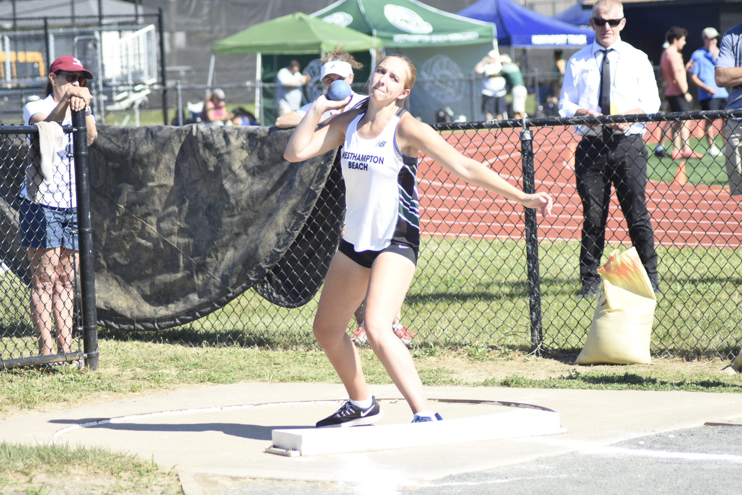 Westhampton Beach freshman Madison Phillips competing in the shot put portion of the pentathlon.