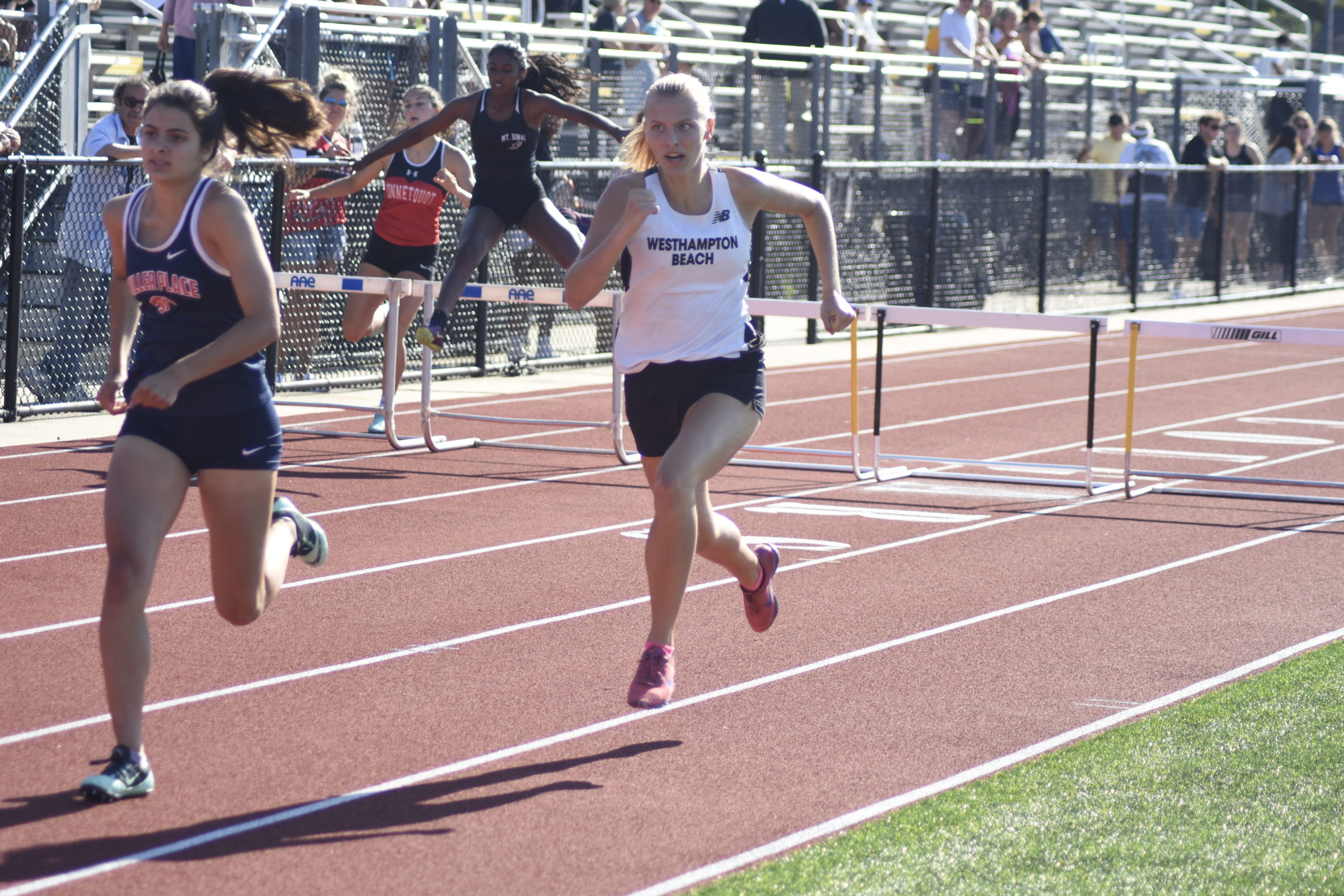 Westhampton Beach junior Valerie Finke running down the final stretch of the 400-meter hurdles, which she placed third in.