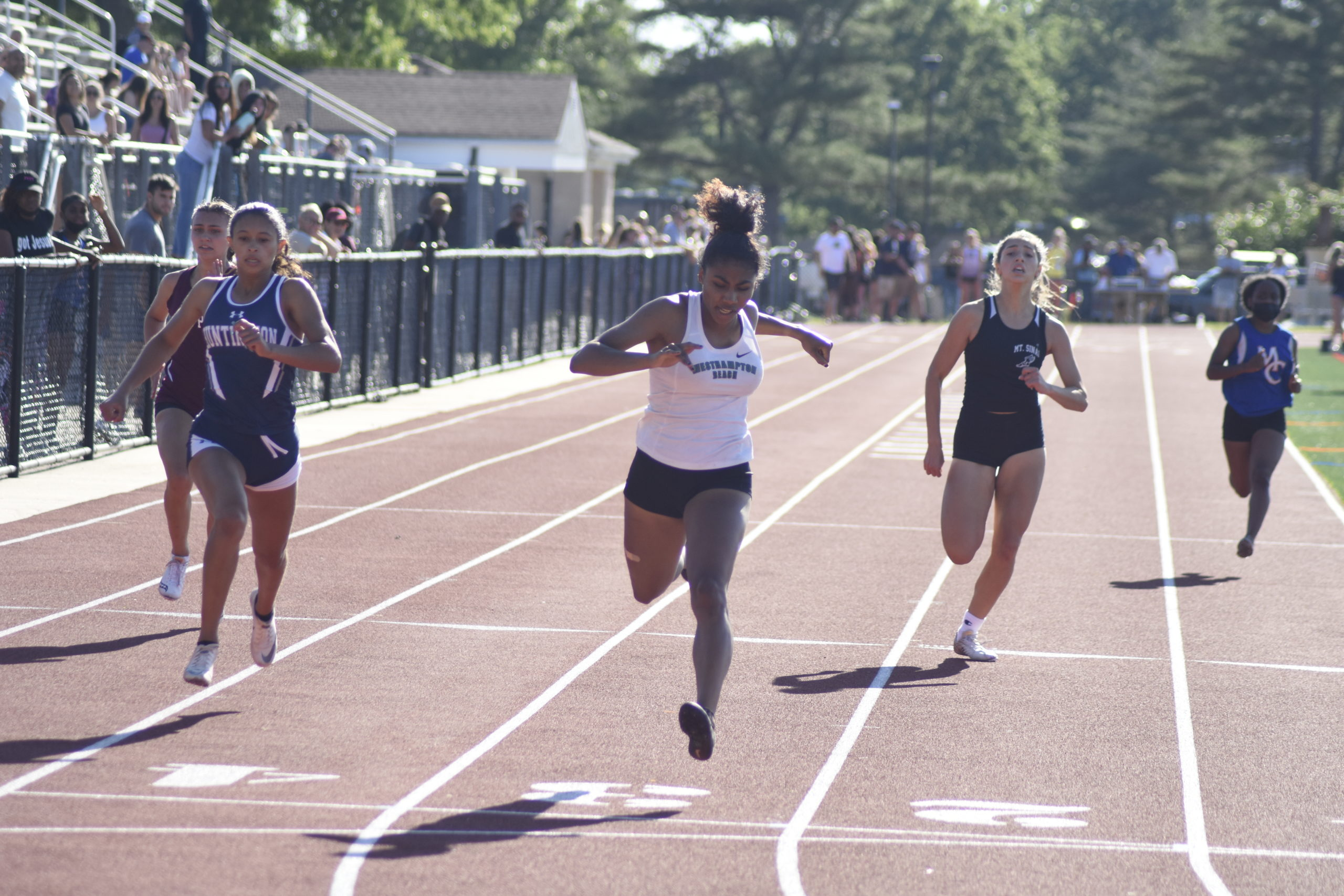 Westhampton Beach senior Oceane Ode crosses the finish line first in the 200-meter dash. She also won the 100-meter dash and was named Sprinter of the Year.