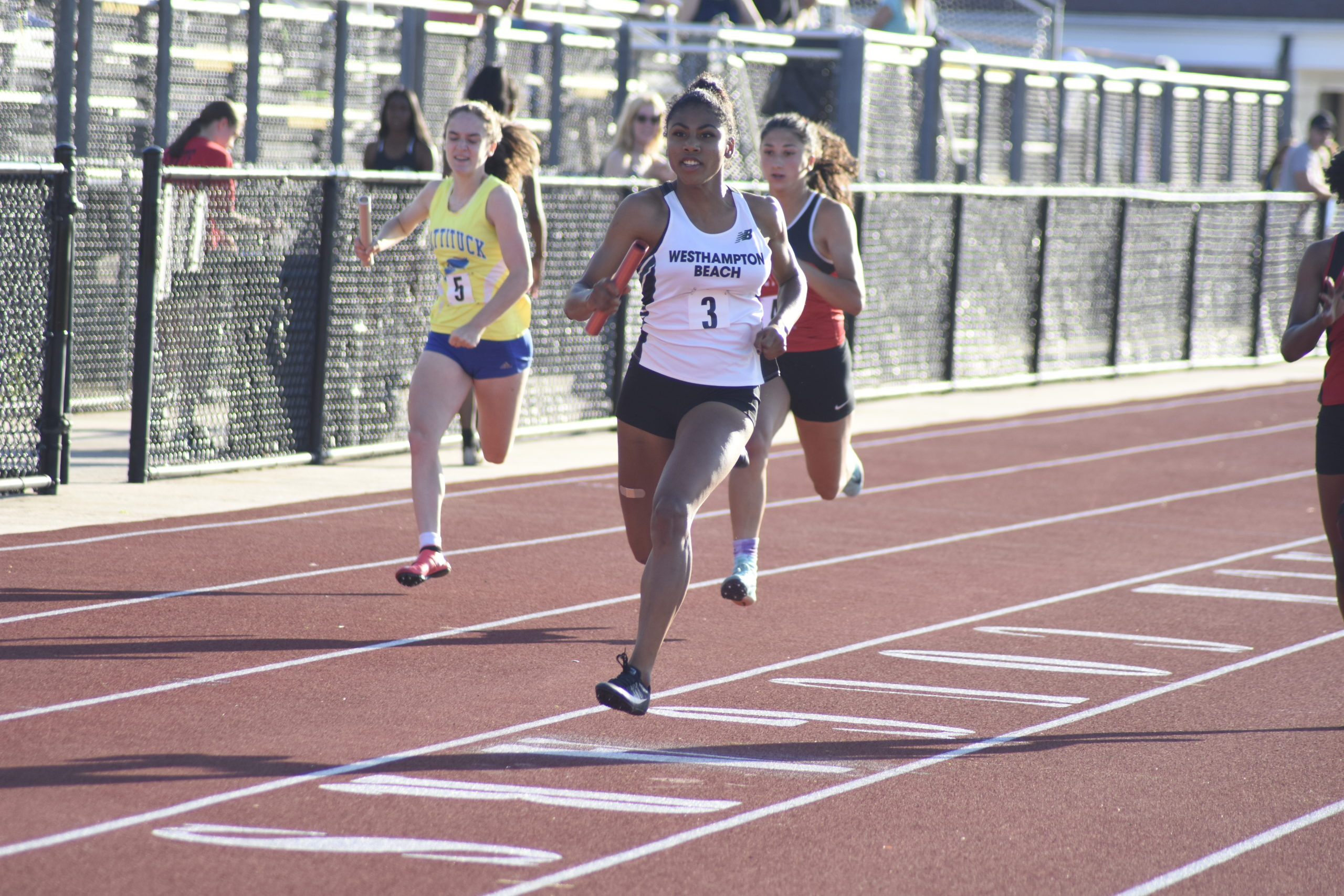 Oceane Ode finishing the final leg of the 4x100-meter dash which placed second at counties.