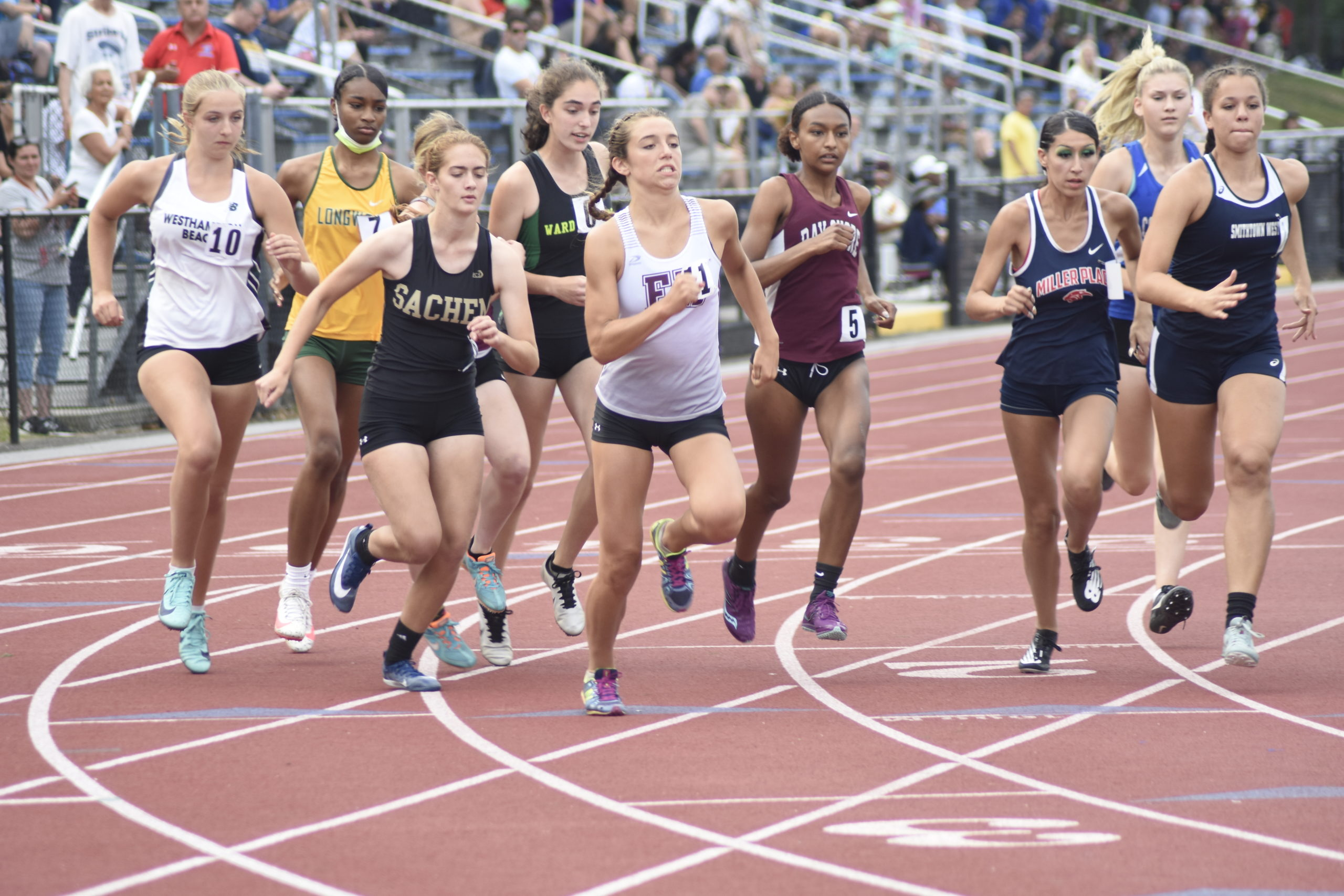 East Hampton senior Bella Tarbet darts over to the head of the pack at the start of the 800-meter run portion of the pentathlon.